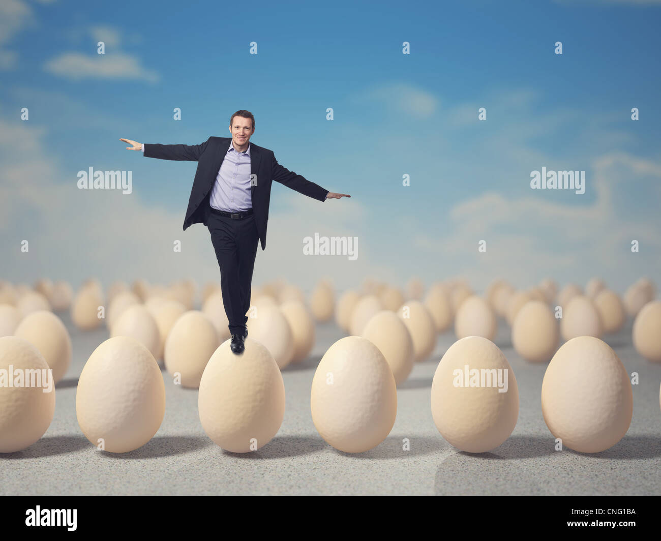 smiling man balance on 3d egg - Stock Image