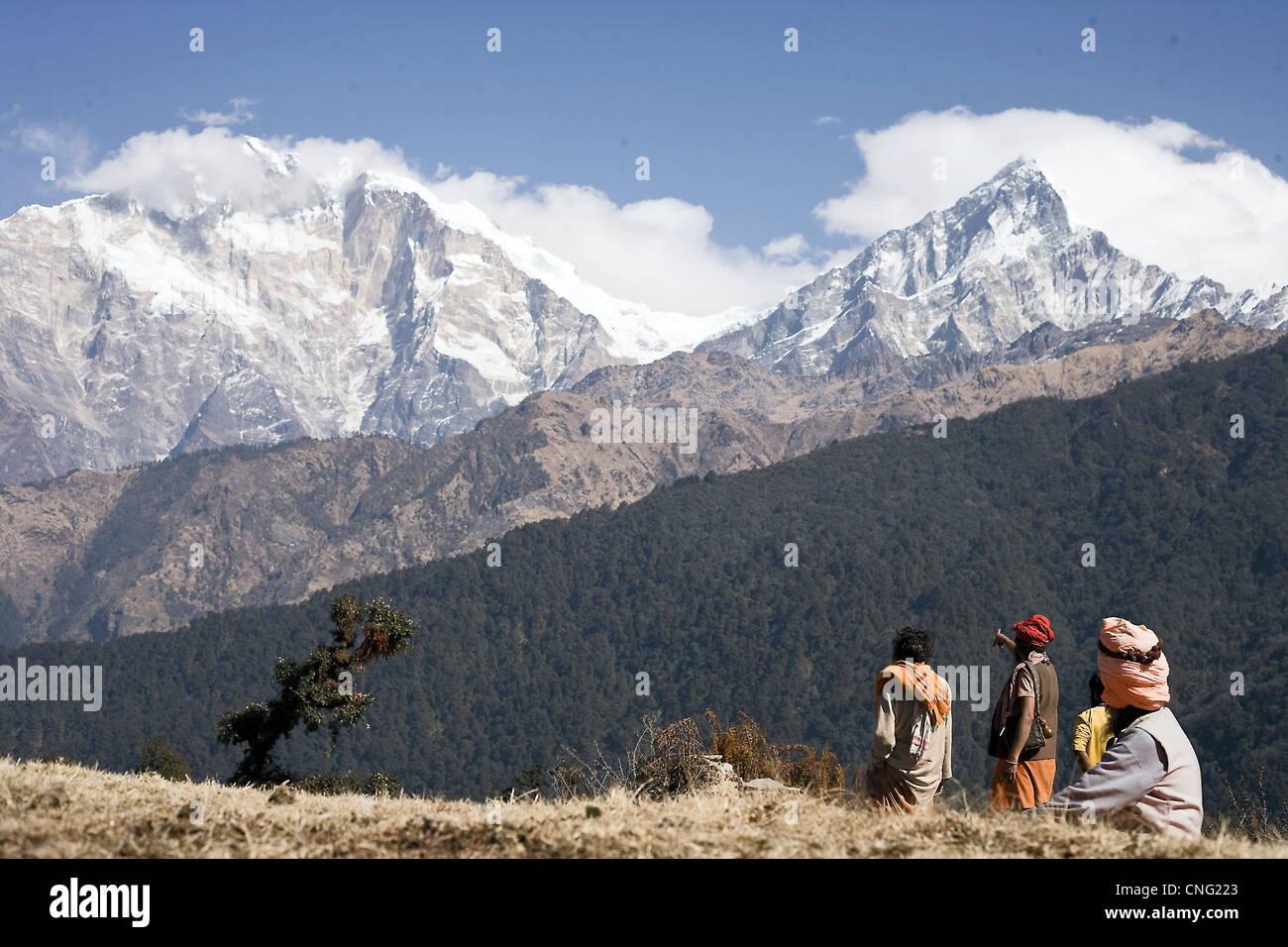 Sadhus looking at Himalayas on the way to holy Muktinath , Nepal - Stock Image