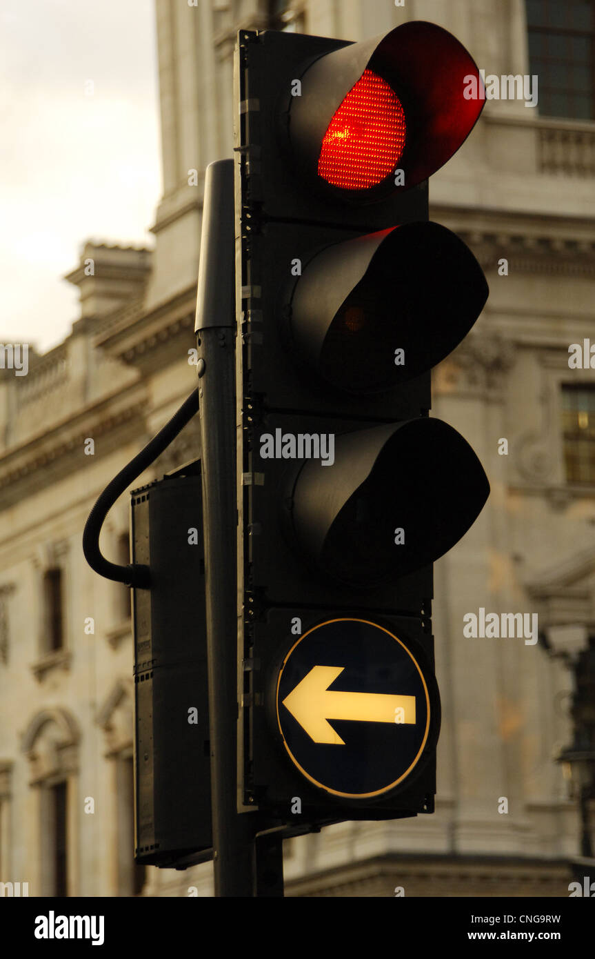 United Kingdom. England. London. Red light for vehicles that turn left. - Stock Image