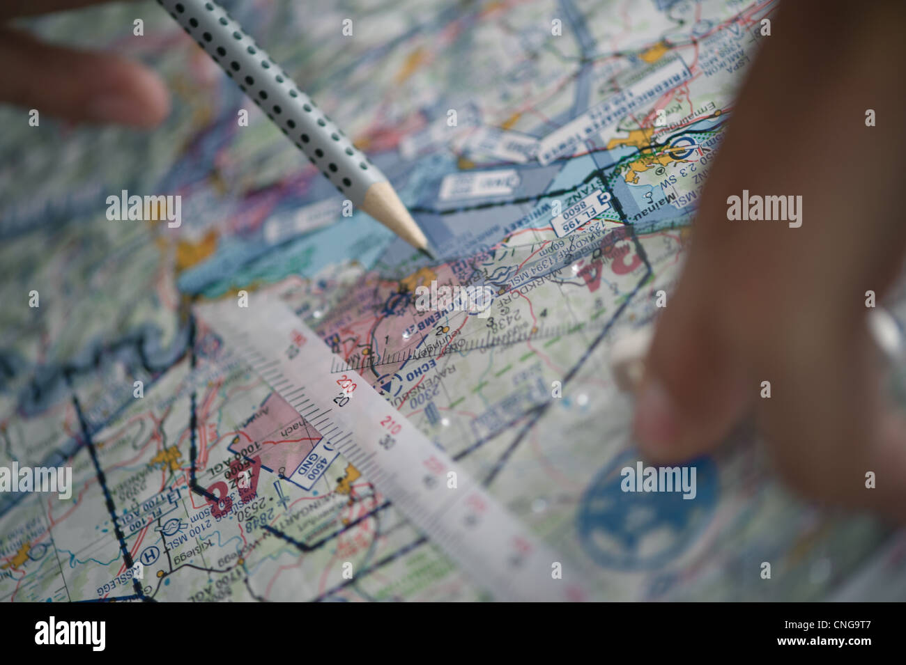 Pre flight planning detail of an aeronautical map with ruler and pencil - Stock Image