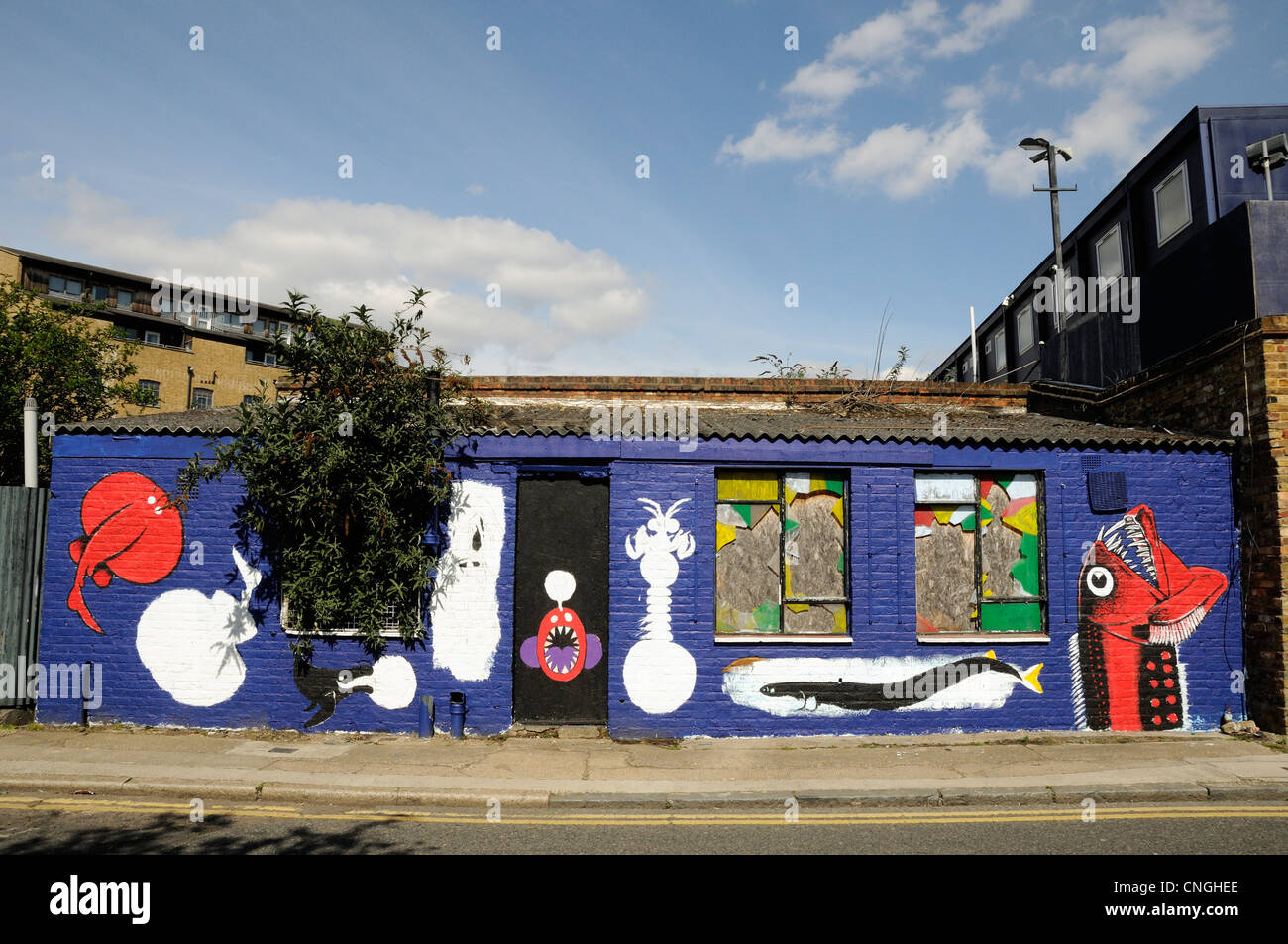 Graffiti on the front of an old single story building, Orchard Place, Blackwall Leamouth Poplar Tower Hamlets East - Stock Image