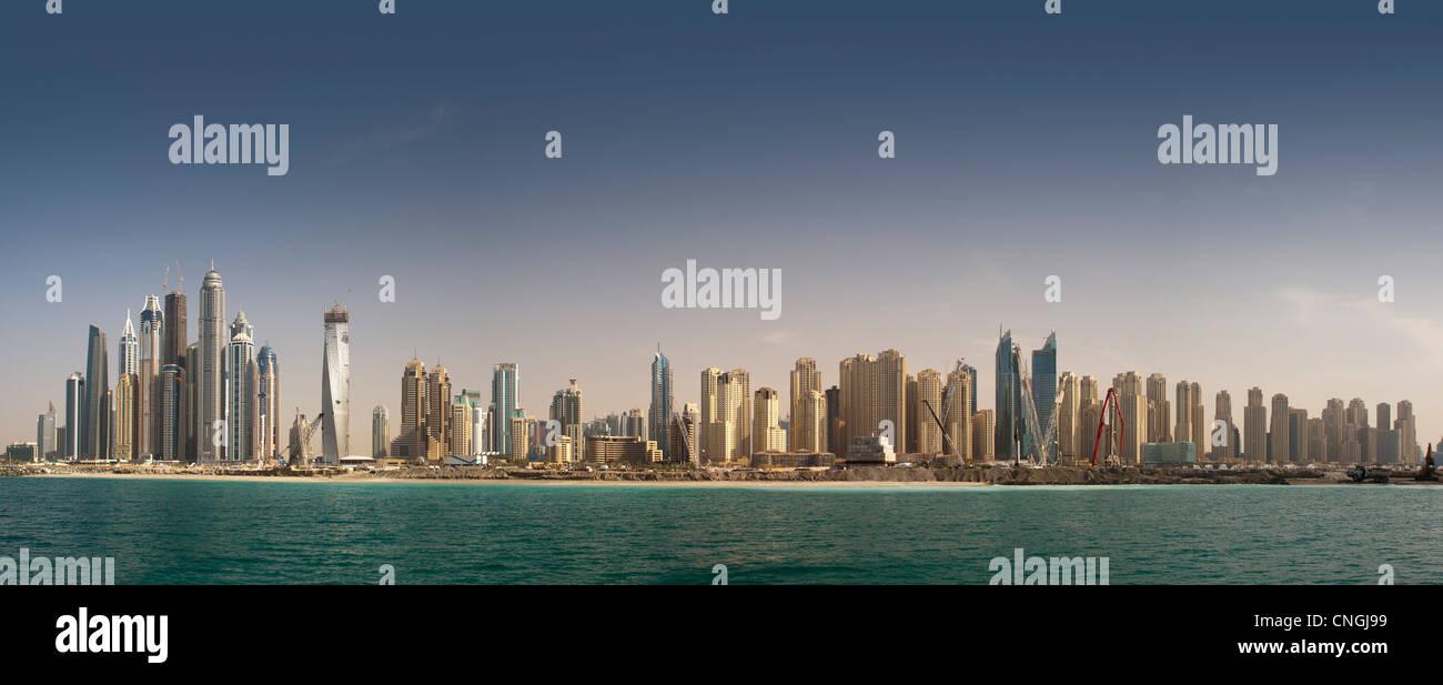 "The skyscrapers of the ""Dubai Marina"" area (Dubai - the United Arab Emirates). Seafront panoramic view. Stock Photo"
