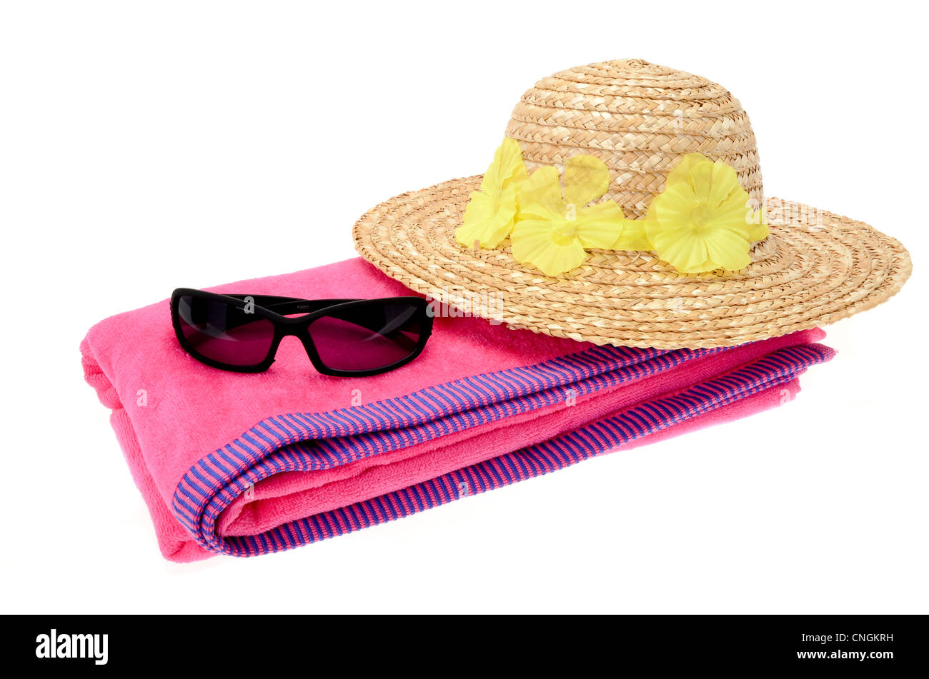 651280859fd18f Pink beach towel with a pair of sunglasses and a ladies sun hat on a white  background