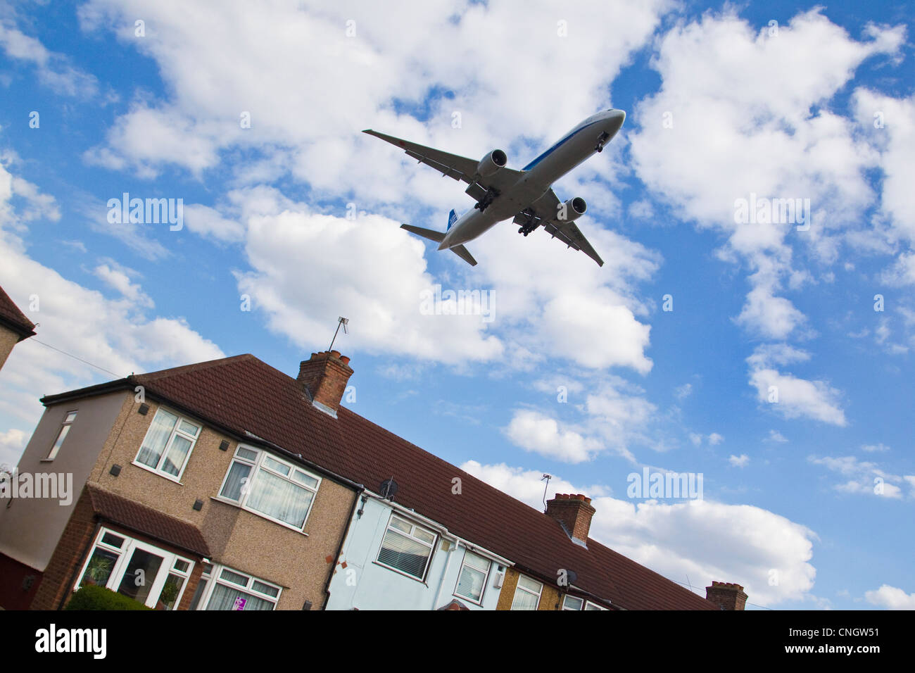 Aircraft landing close to rooftops of houses in Cranford, near Heathrow Airport, where a third runway is planned. - Stock Image