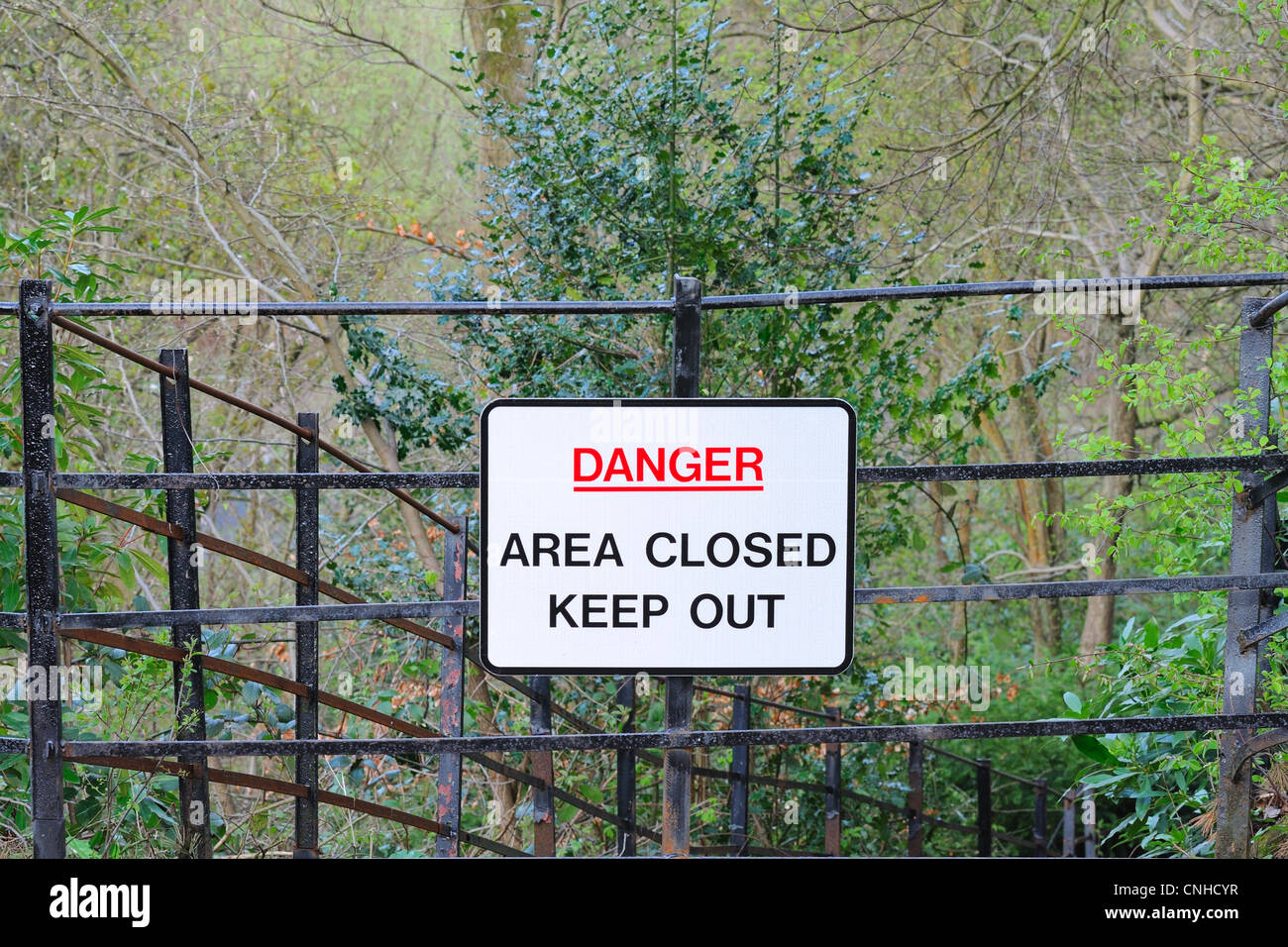 Warning sign stating Danger, area closed off to public. - Stock Image