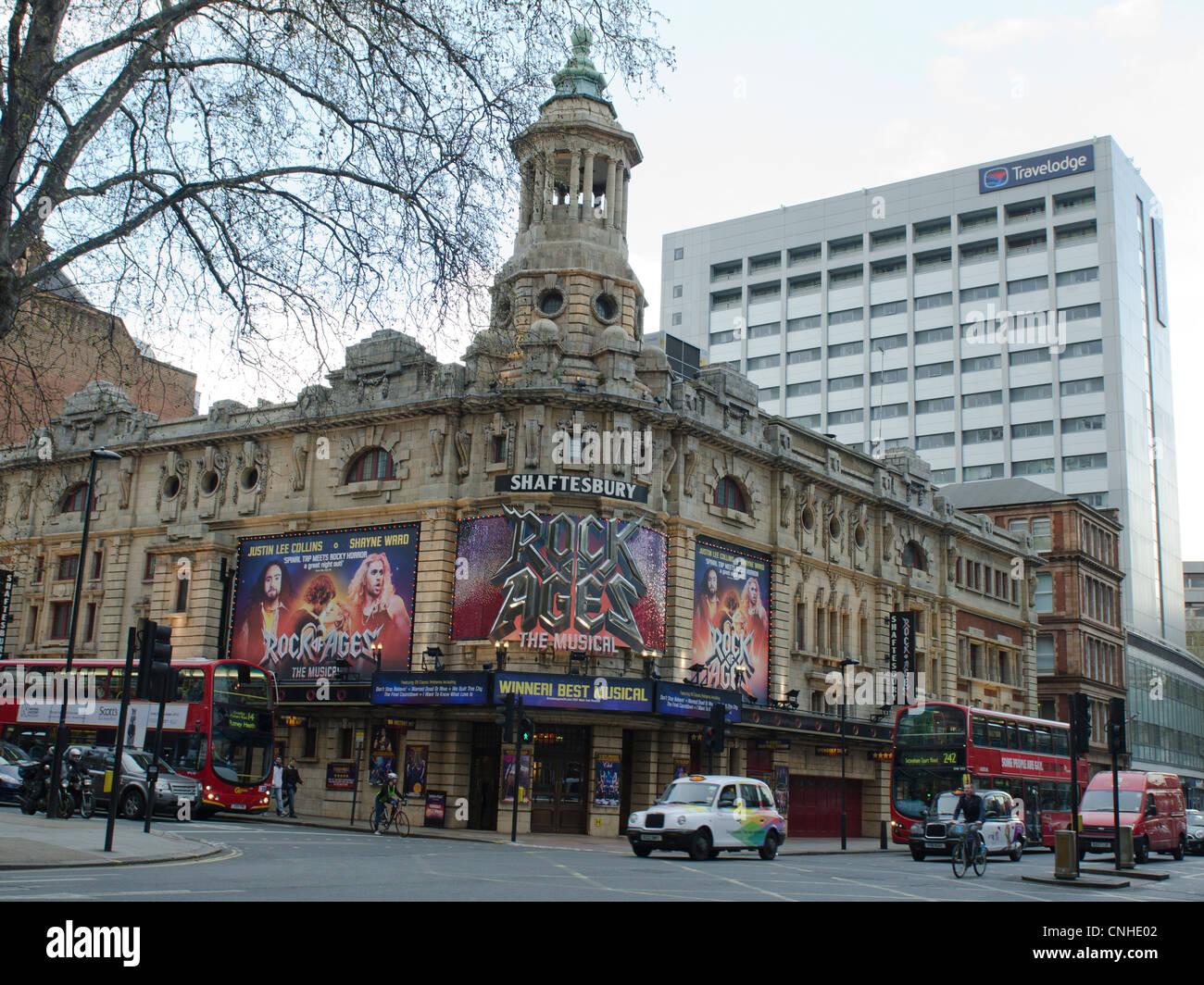 Shaftesbury Theatre billboard for Rock of ages the musical. Travelodge behind - Stock Image