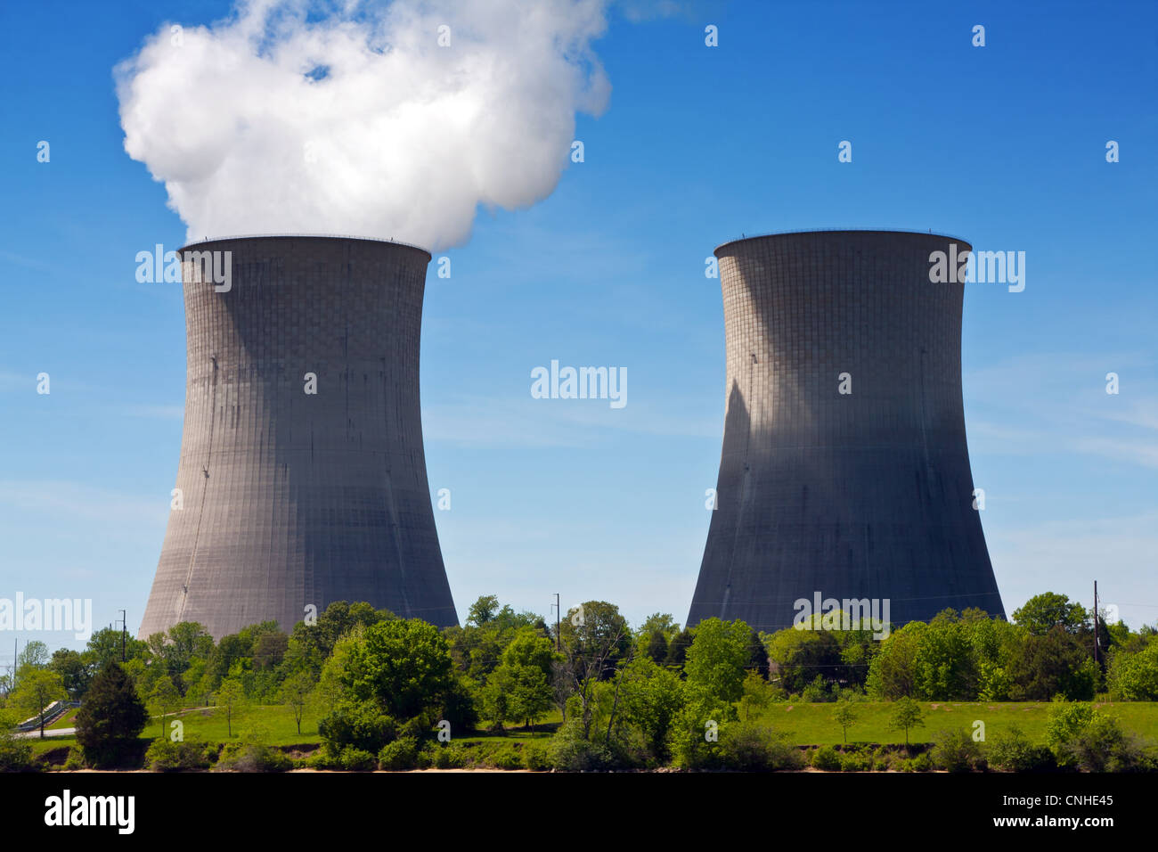 Two cooling towers at a nuclear power generating station. - Stock Image