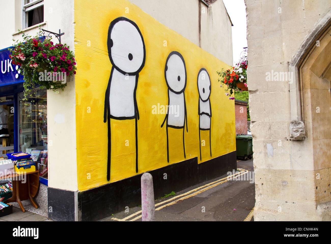 A spray paint mural of graffiti art by Street Artist Stik in an ...