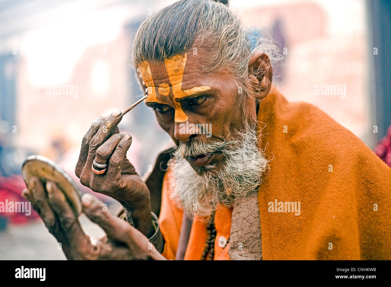 Sadu applying auspicious marks (tilak) during Shivaratri at Pashupatinath - Stock Image