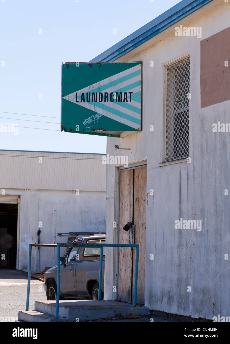 Old, worn laundromat sign - Stock Image