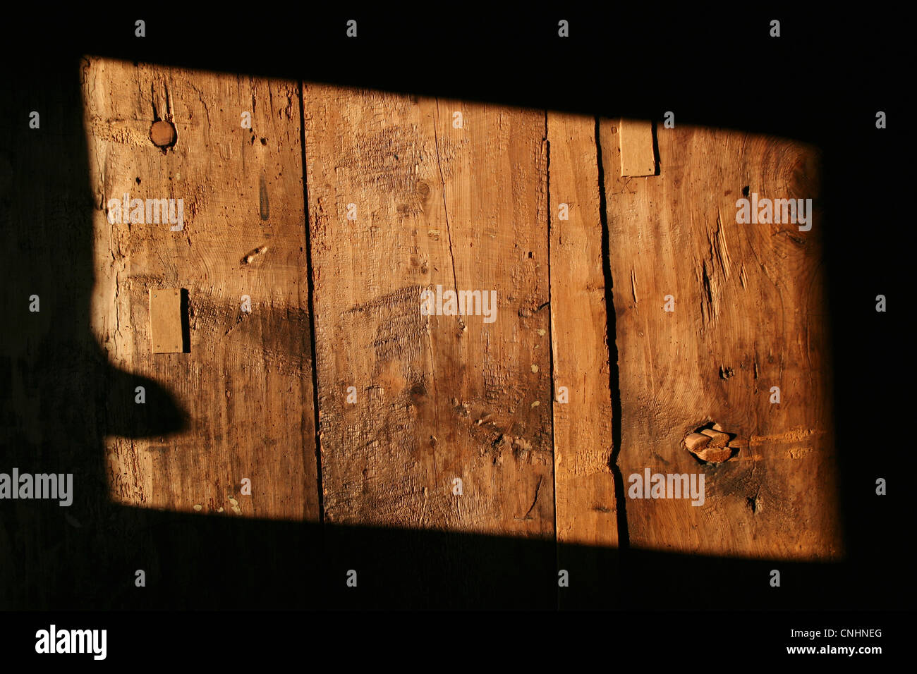 A rectangle shape of sunlight on a wooden structure, close-up - Stock Image
