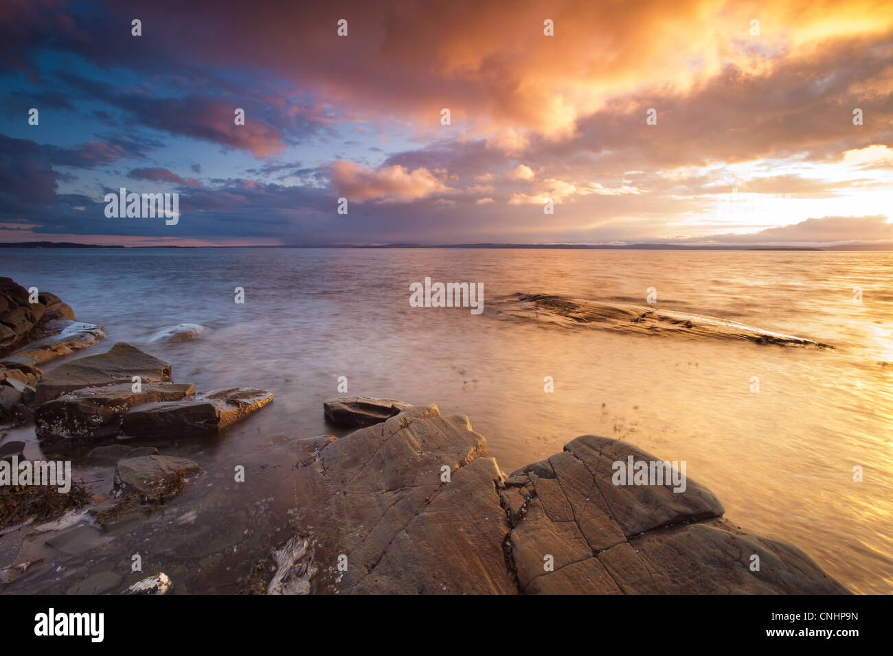 Beautiful sunset by the Oslofjord at Nes on the island Jeløy, Oslofjorden, Norway. - Stock Image