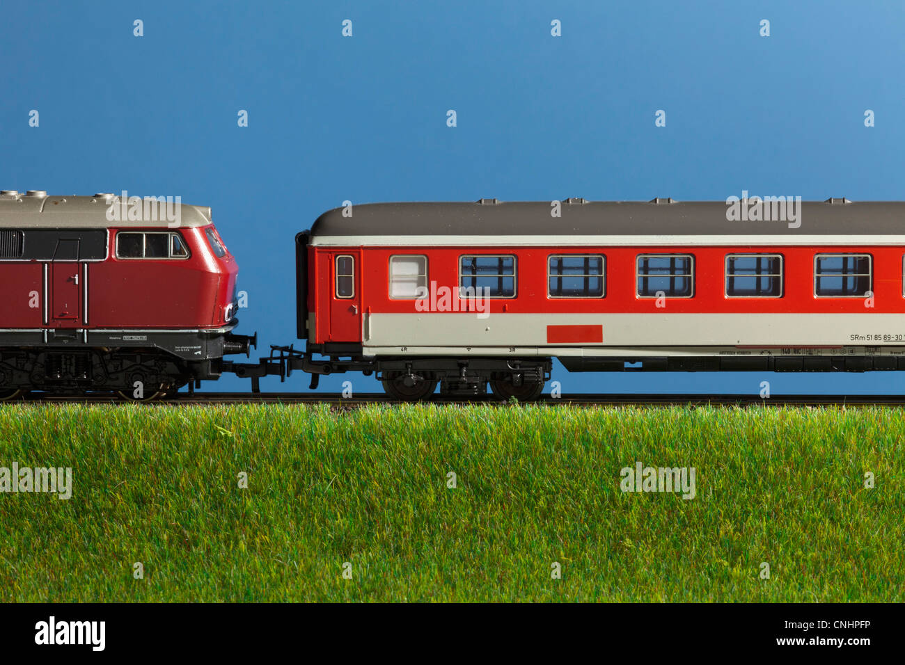 A miniature toy passenger train Stock Photo