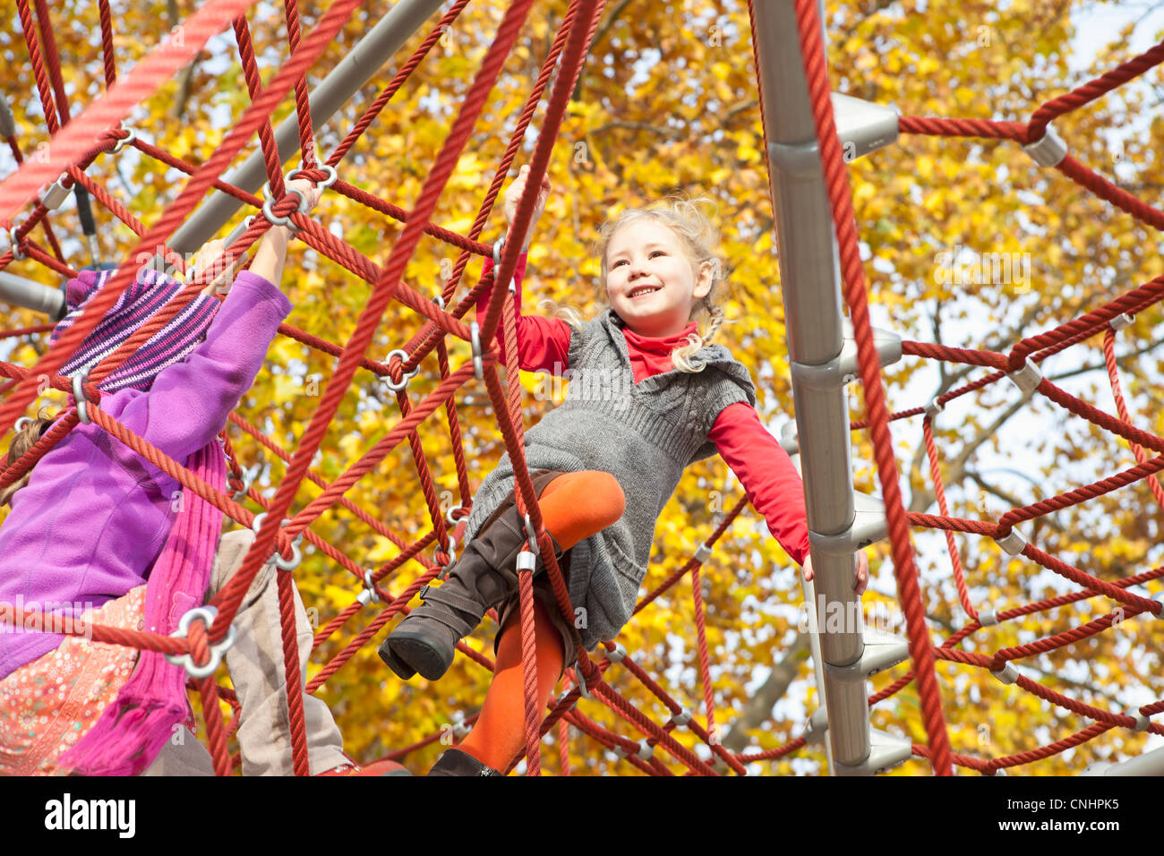 Kids on jungle gym - Stock Image