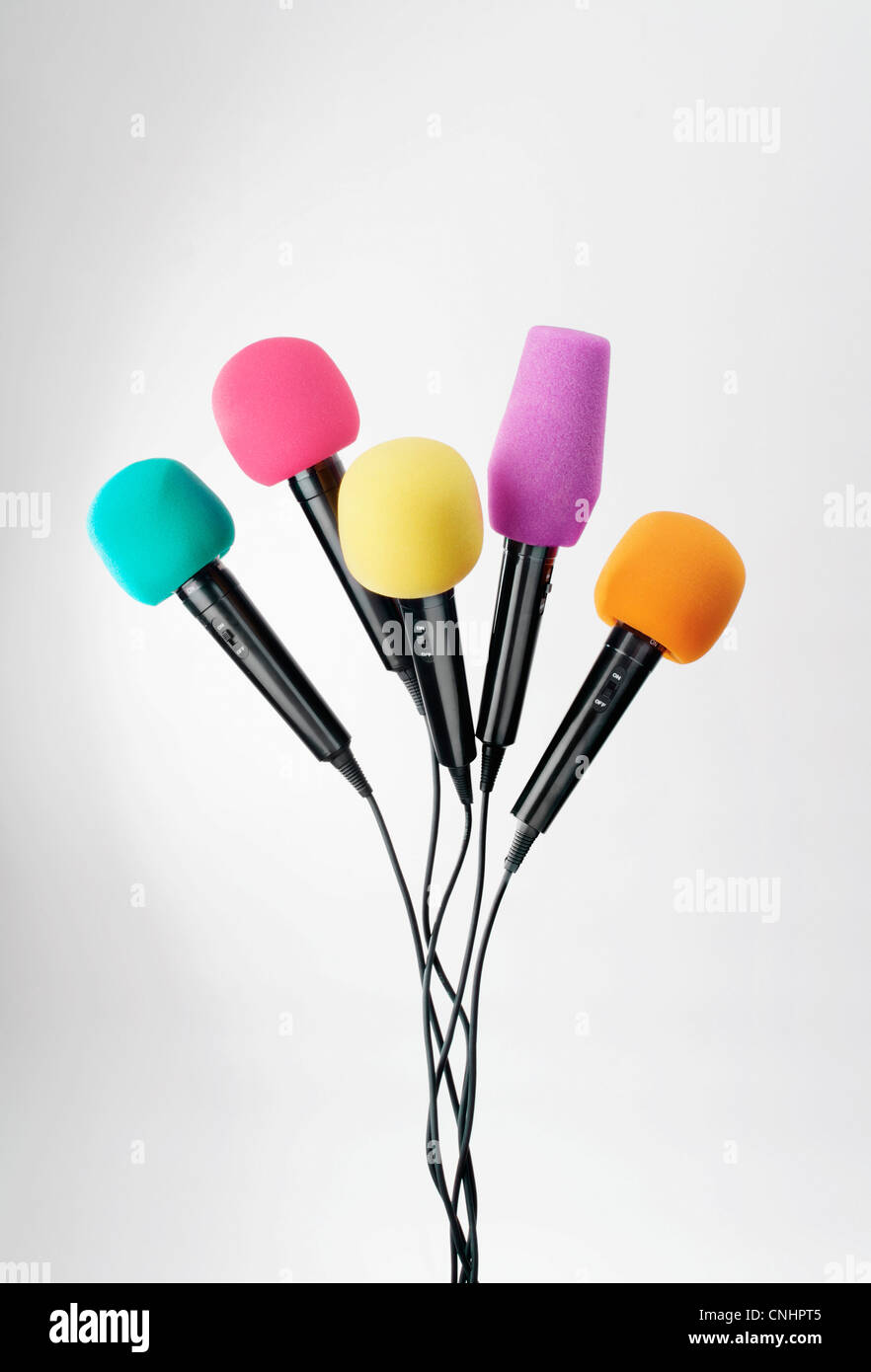 Various colored microphones - Stock Image