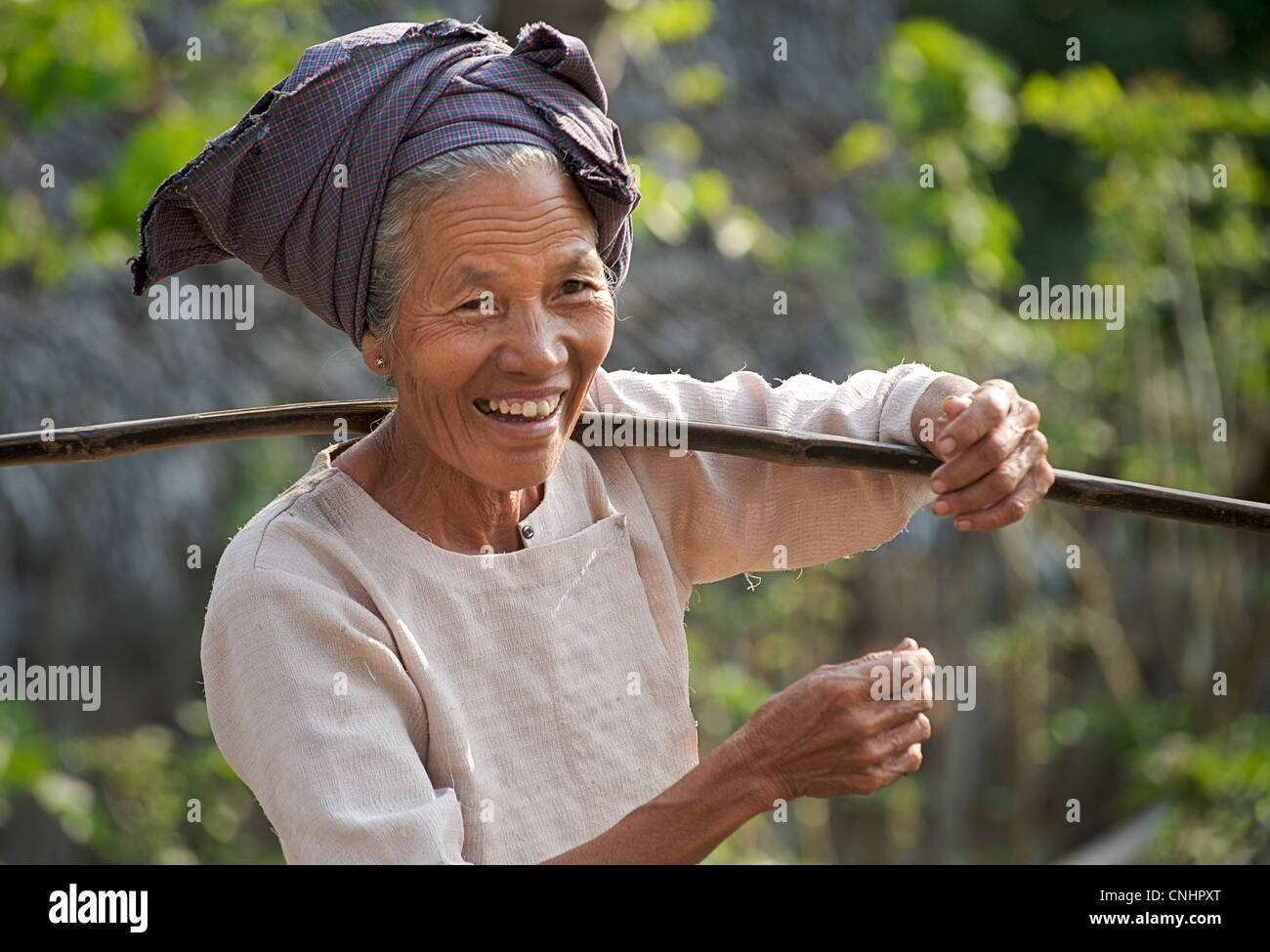 Burmese woman, near Mount Popa, Burma - Stock Image