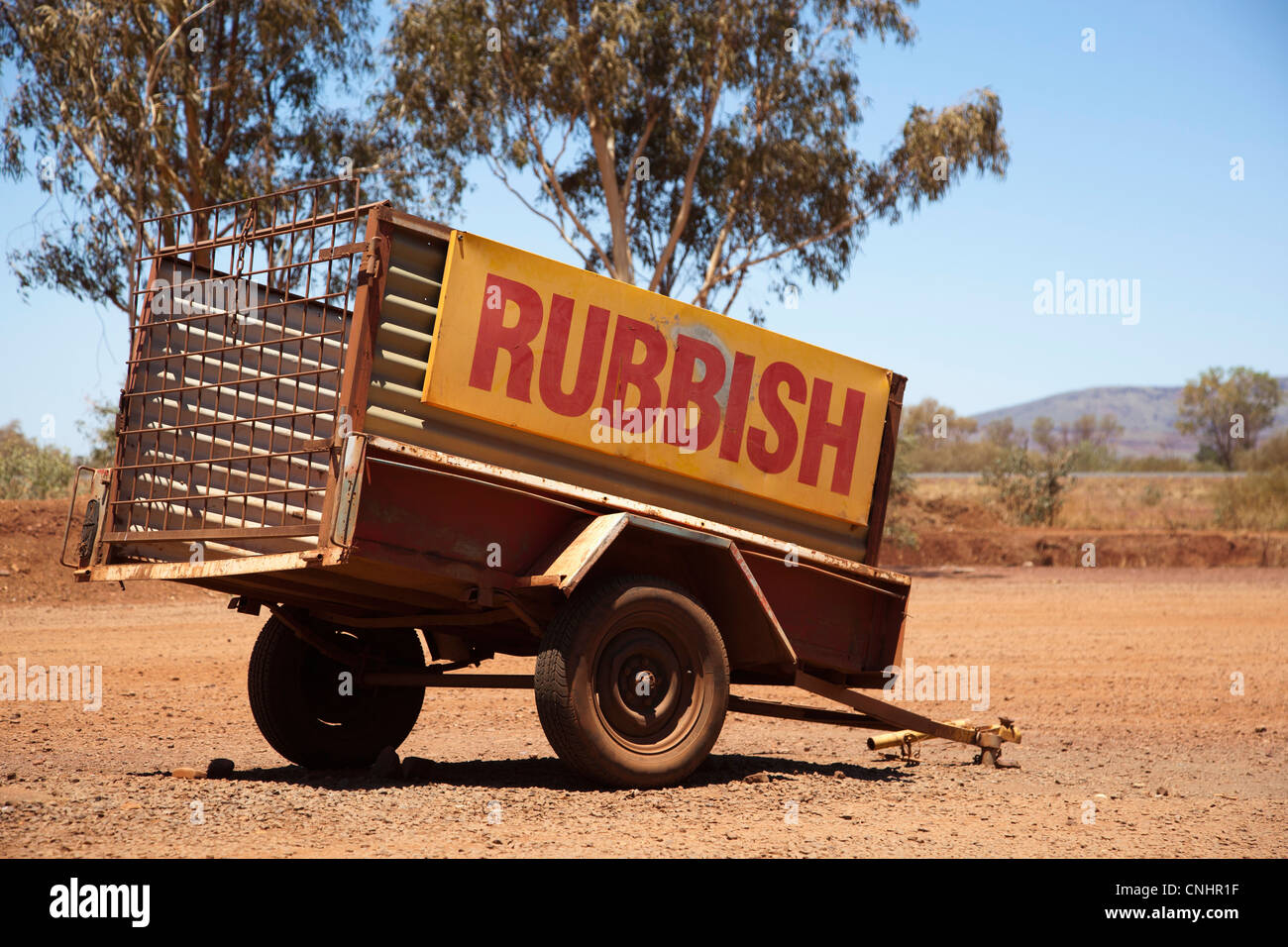 A vehicle trailer with the word Rubbish on it - Stock Image