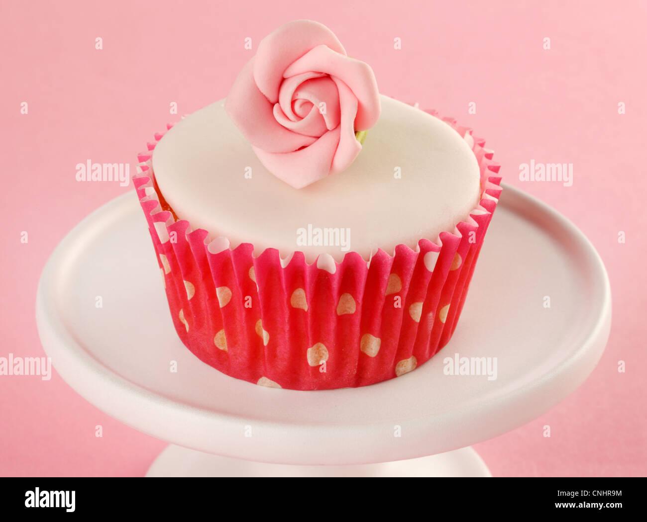 PINK ROSE CUPCAKE - Stock Image