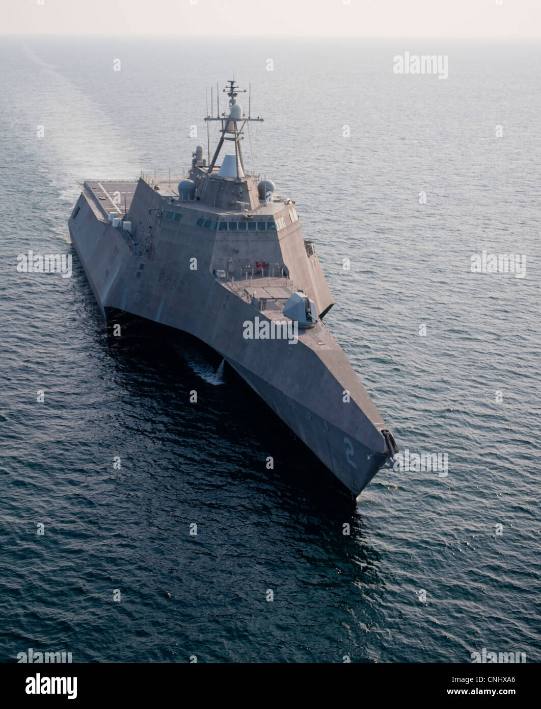 The new USS Independence, a littoral combat ship, steams through the Atlantic Ocean April 9, 2012 off the coast - Stock Image