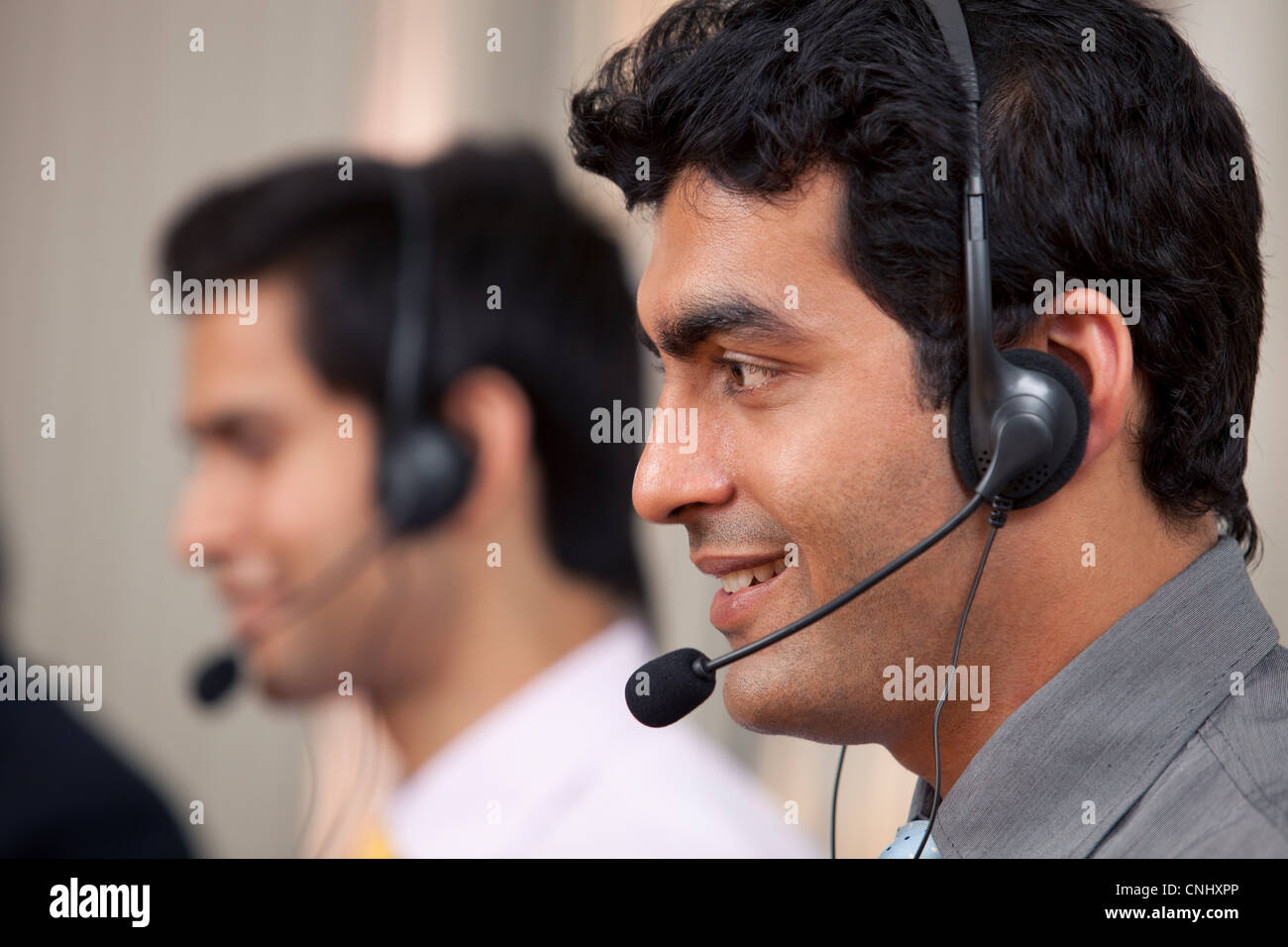 Call center agent smiling - Stock Image