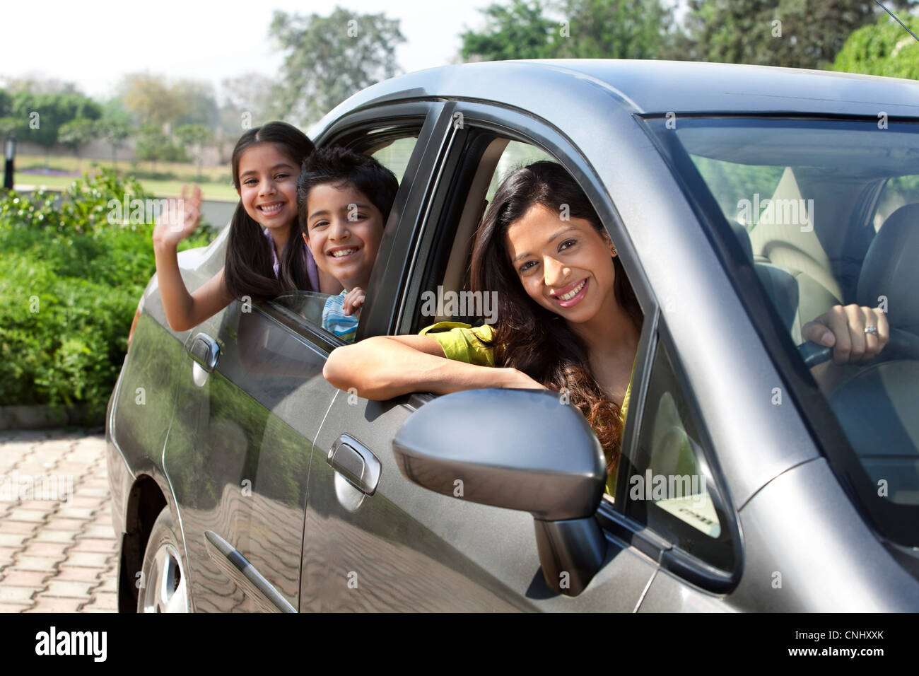 Portrait of mother and kids in a car Stock Photo
