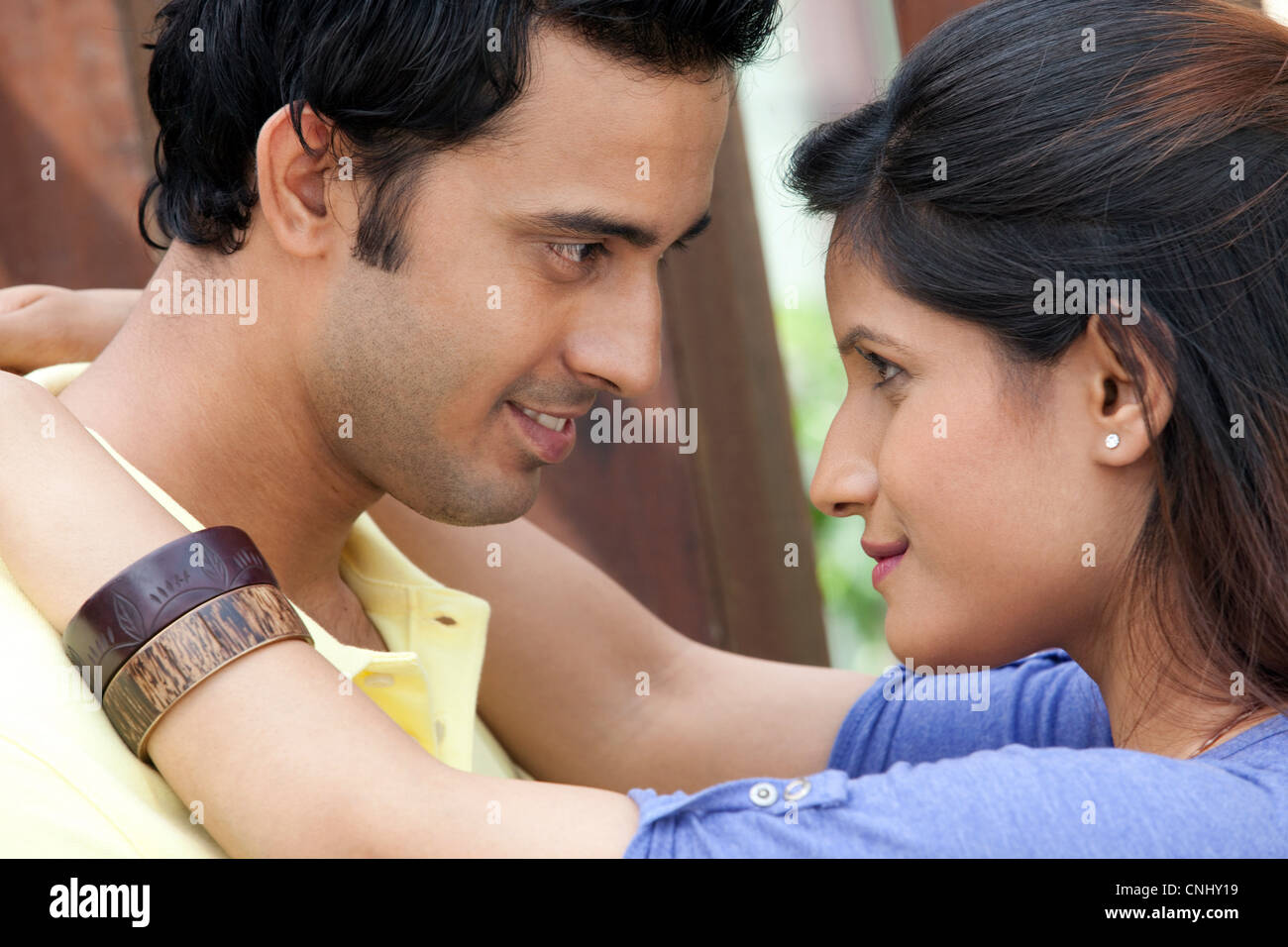 Couple looking into each others eyes - Stock Image