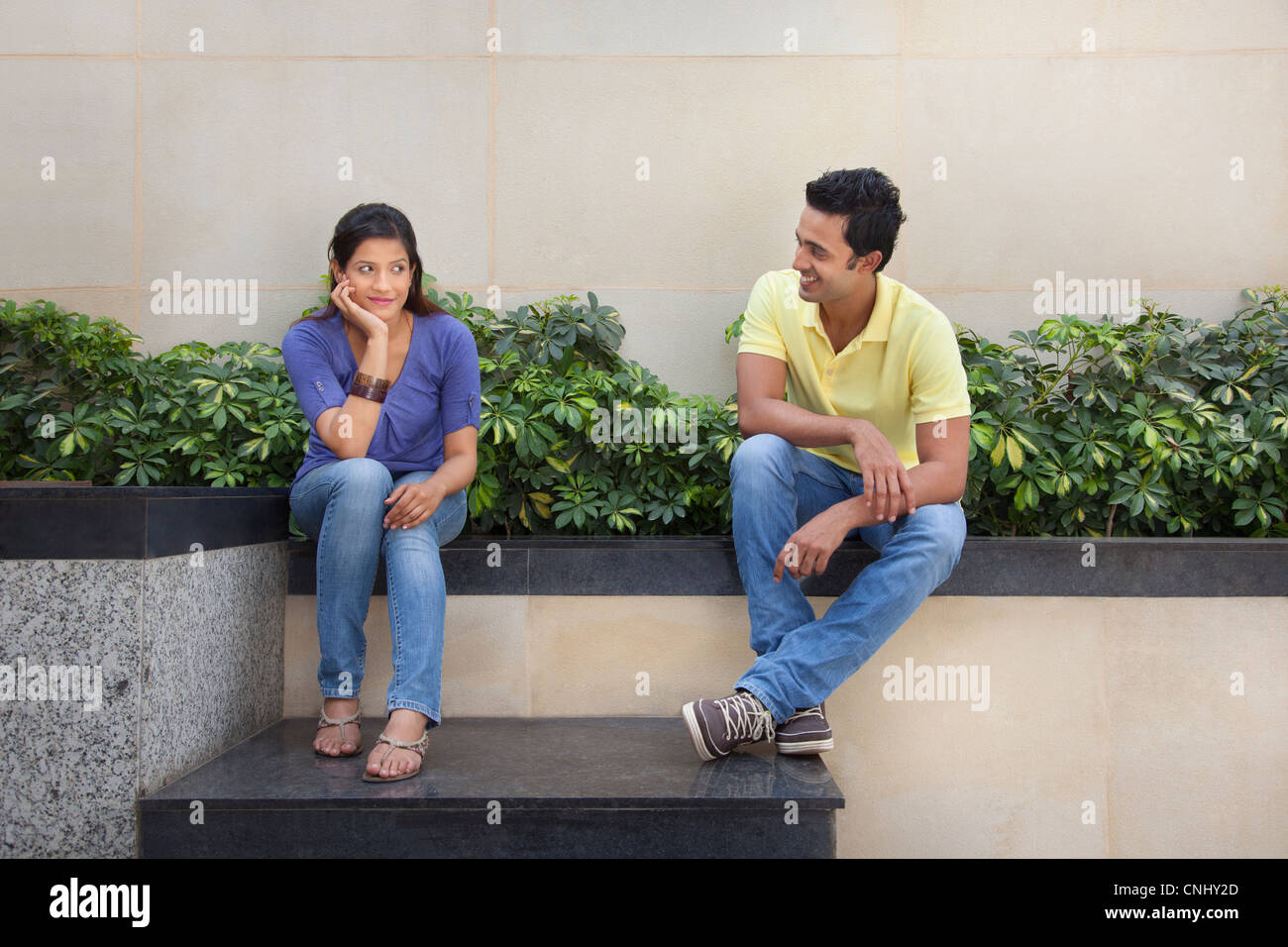 Couple sitting outside - Stock Image