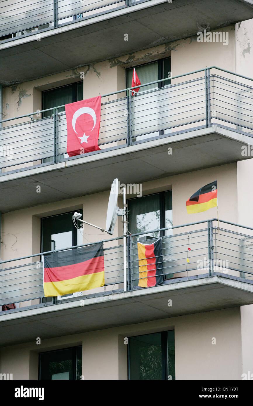 Turkish and German flags on balconies, Kreuzberg, Berlin, Germany - Stock Image
