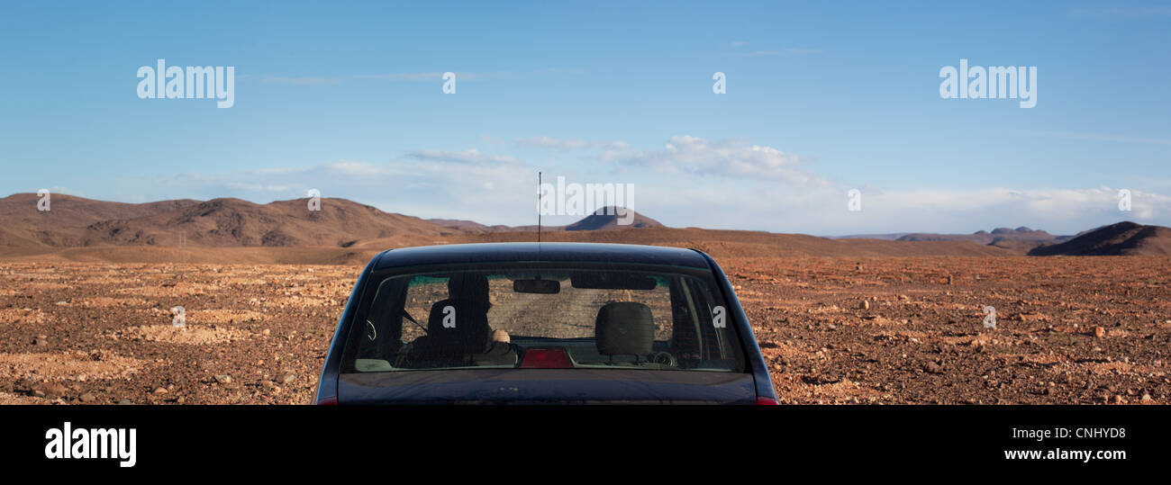 Car in stony desert, Morocco, North Africa - Stock Image