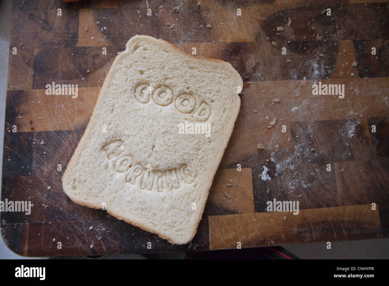 Good morning stamped into bread - Stock Image
