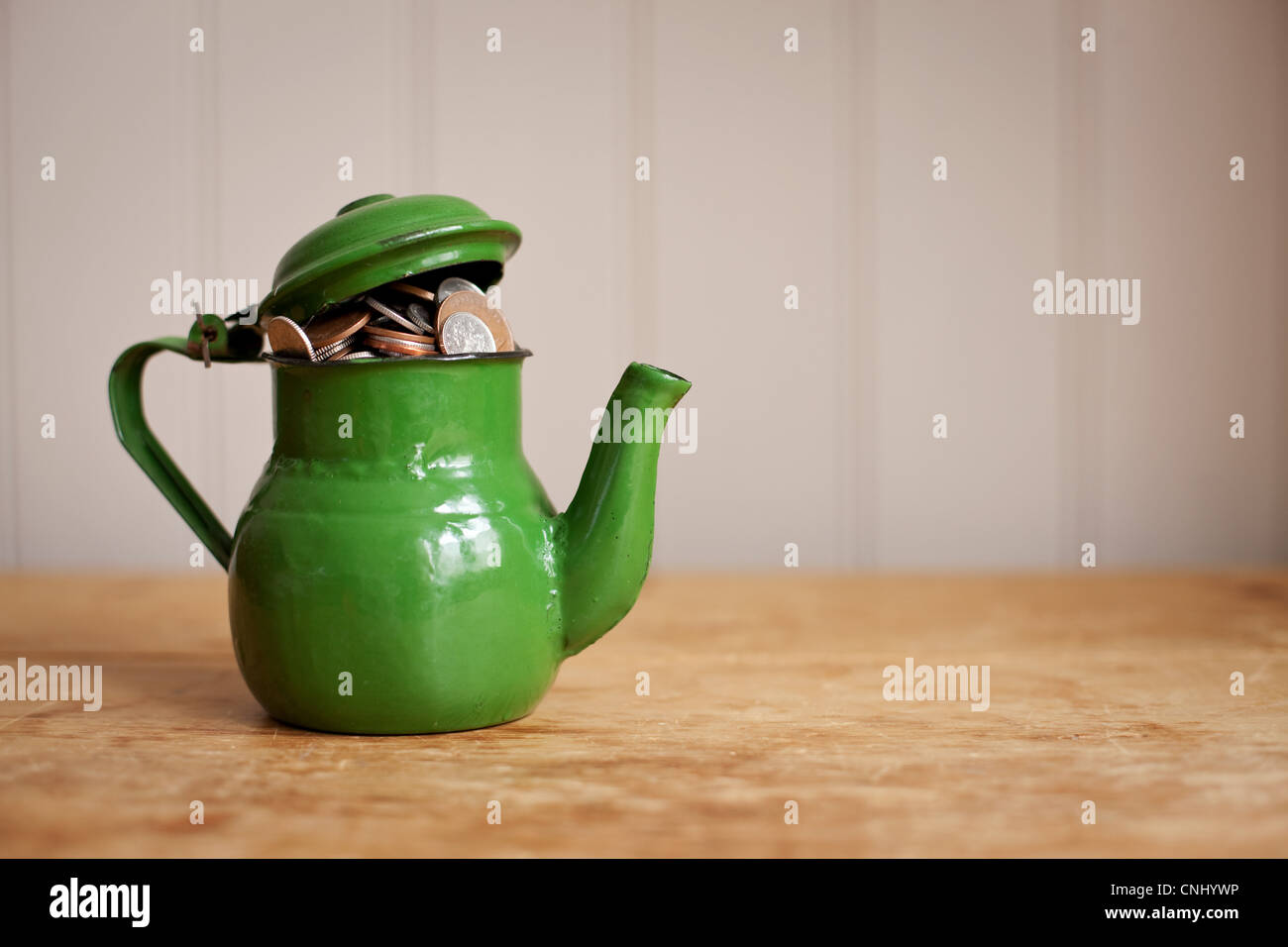 Money in a teapot Stock Photo