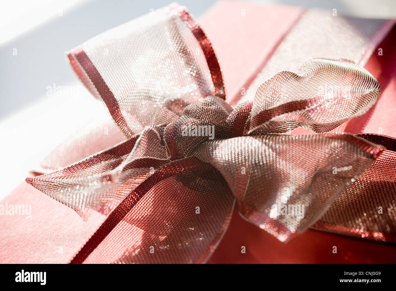 Red gift with ribbon bow - Stock Image