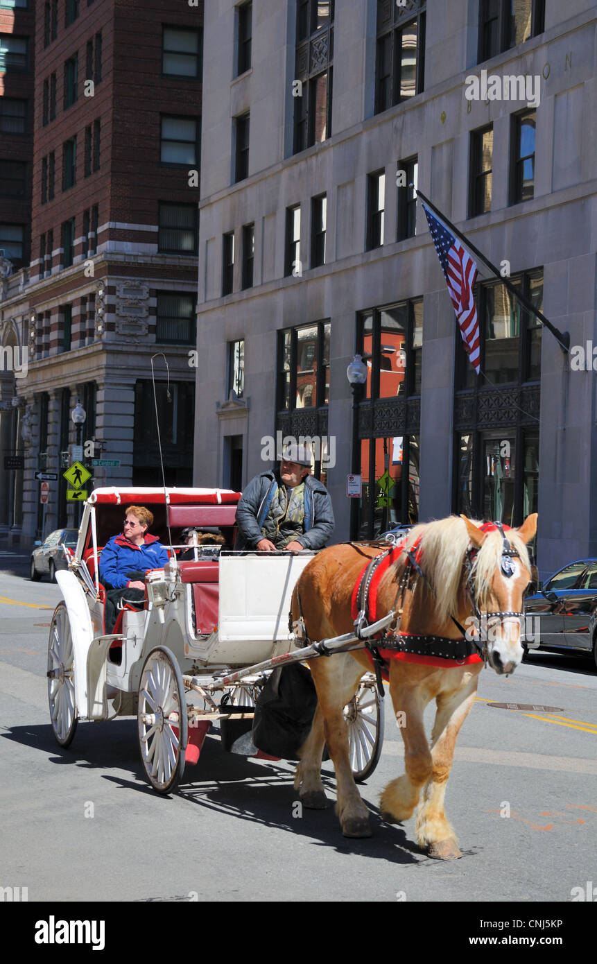 Horse-drawn carriage in the financial district of Boston, Massachusetts. - Stock Image