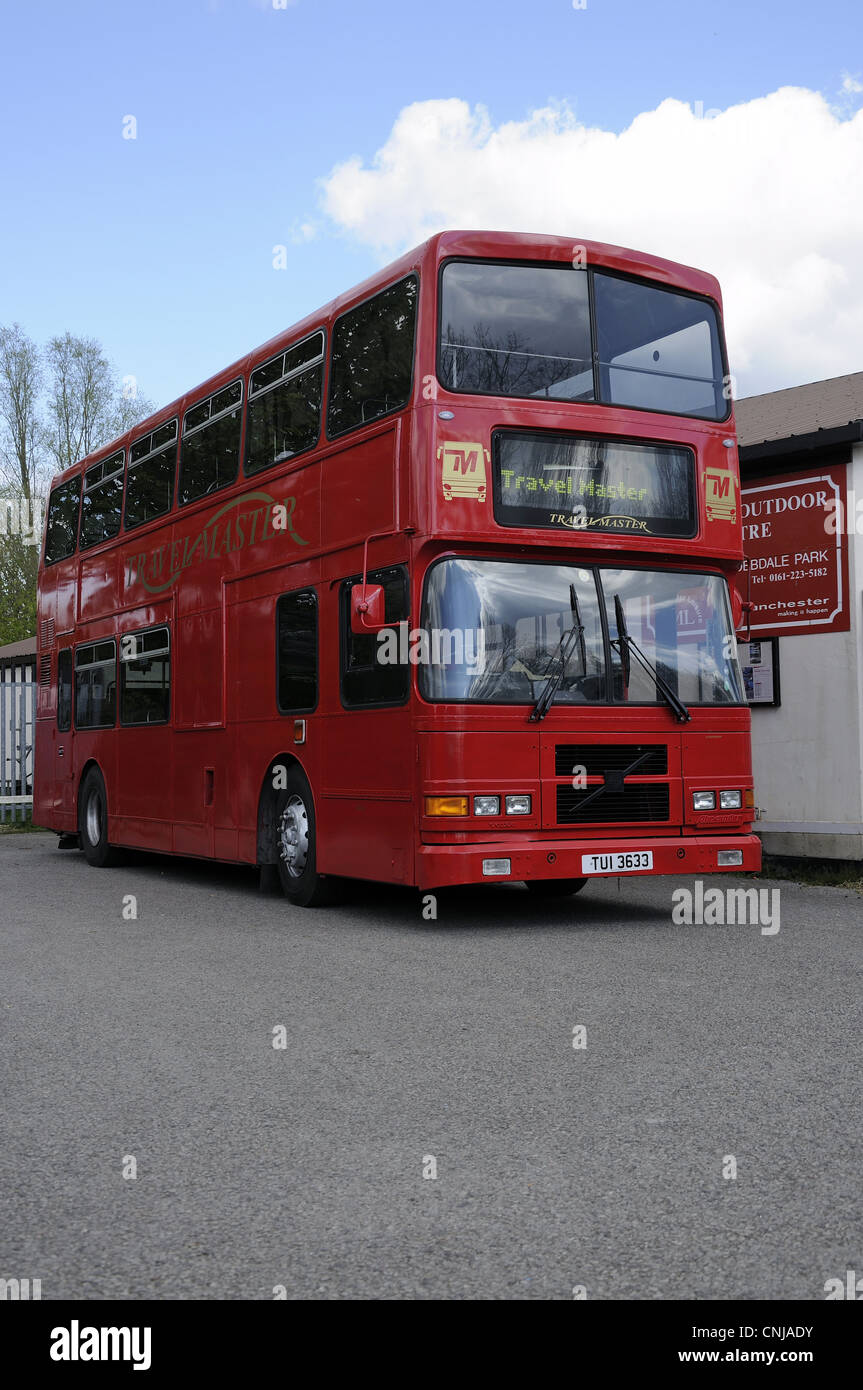 Red double decker Travelmaster bus - Stock Image