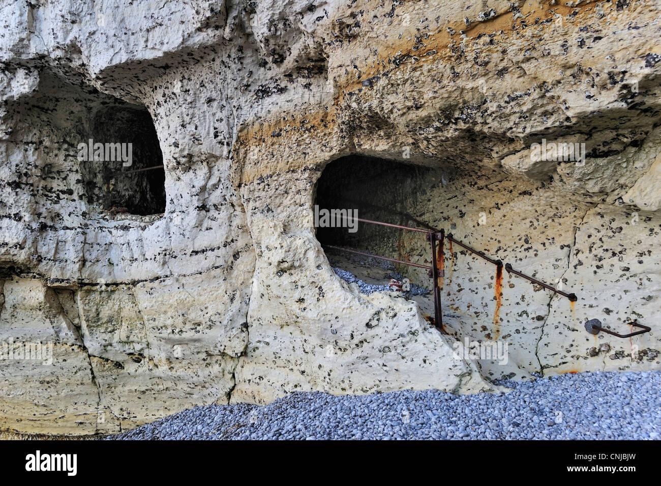 Trou à l'Homme, a passage tunnelling through the chalk cliff Porte D'Aval at Etretat, Côte d'Albâtre, - Stock Image