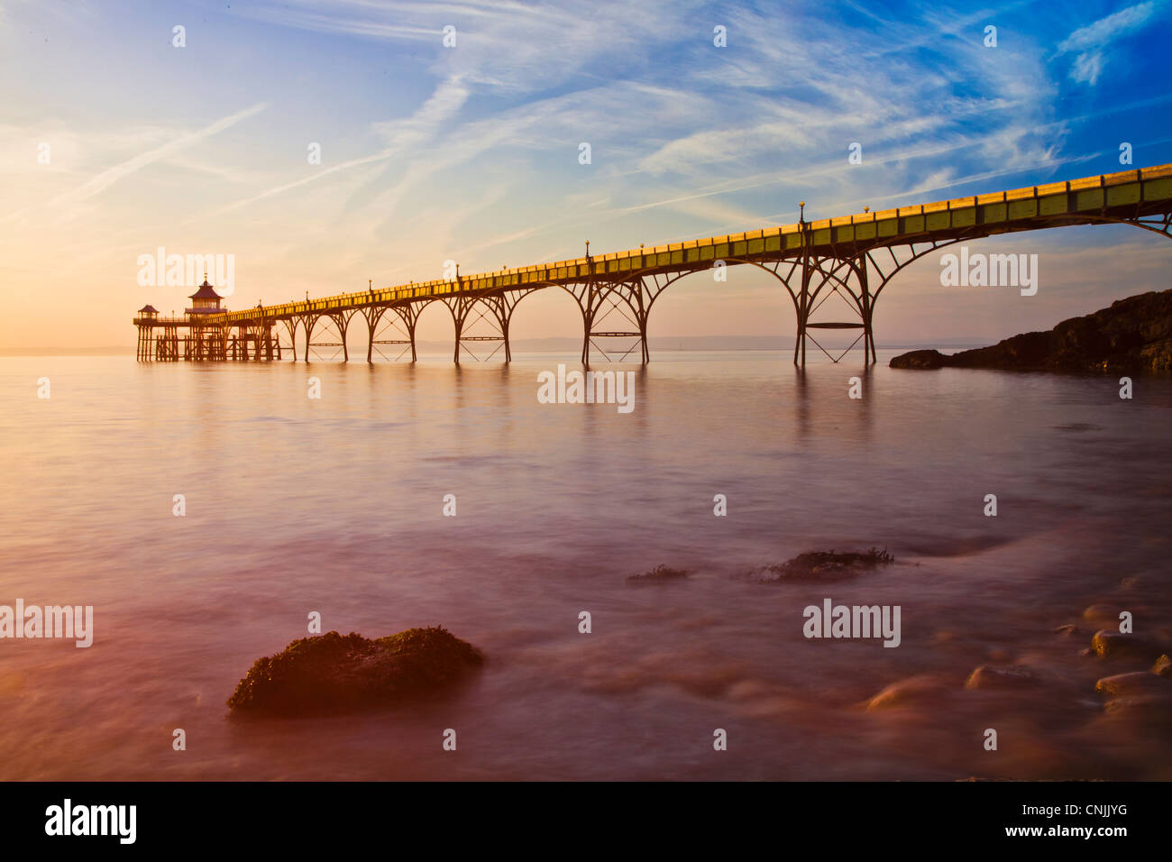 Evening light falls on the Pier at Clevedon, Somerset, England, UK - Stock Image