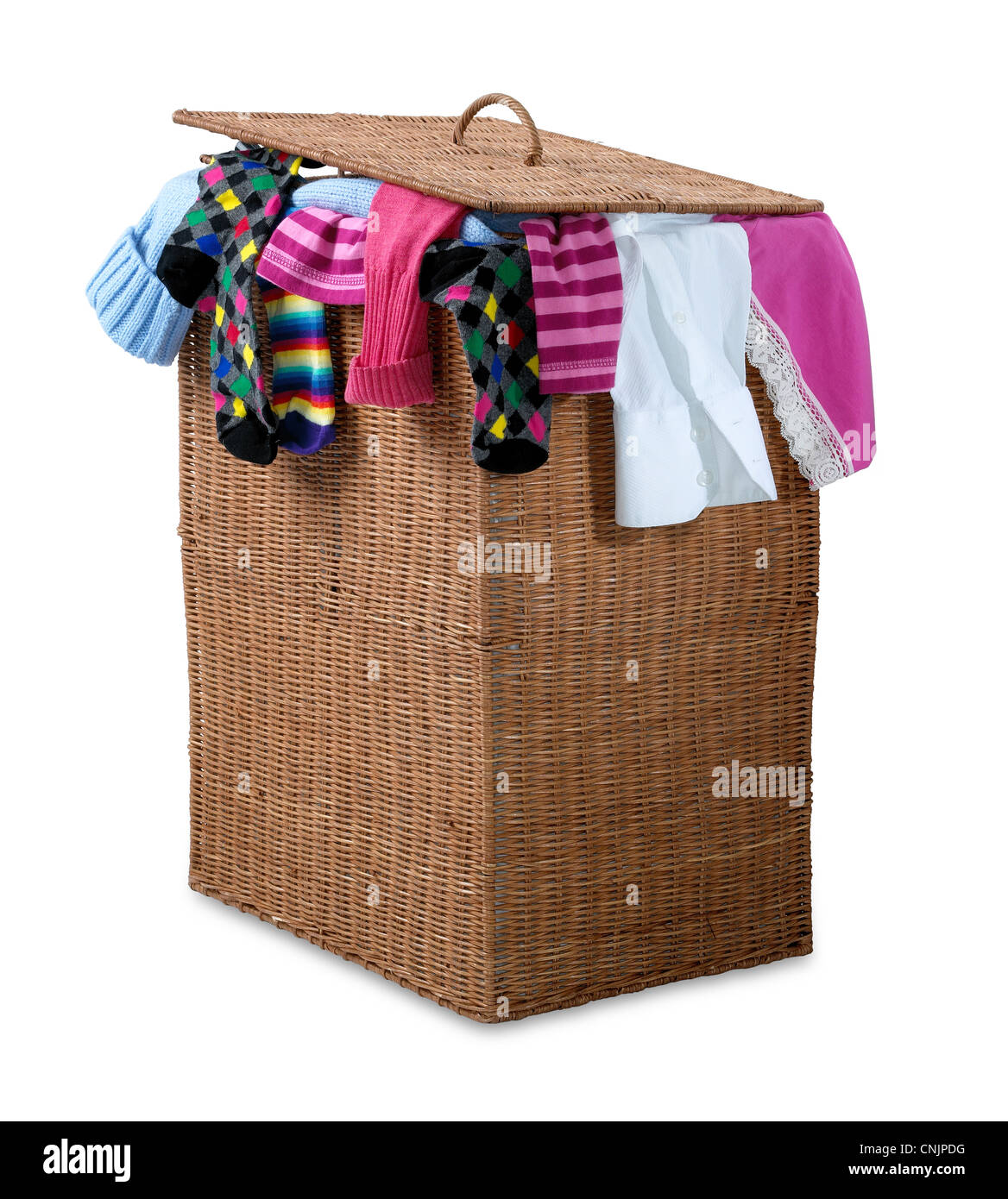 an overflowing wicker laundry basket isolated on white with clipping path showing a bust hectic lifestyle - Stock Image