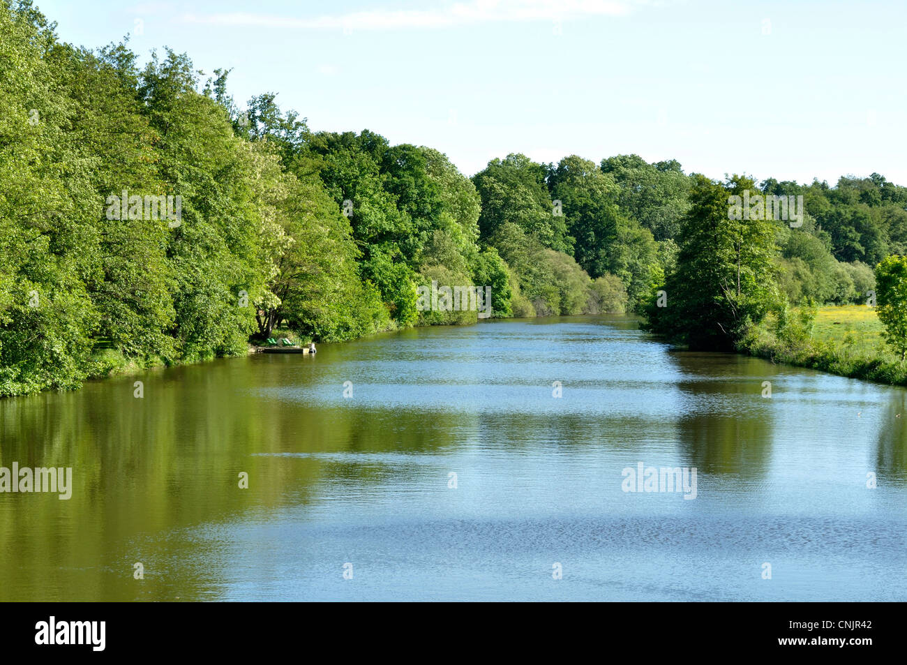 "River lined with trees : ""La Mayenne"", in spring (Mayenne department, Loire country, France). Stock Photo"