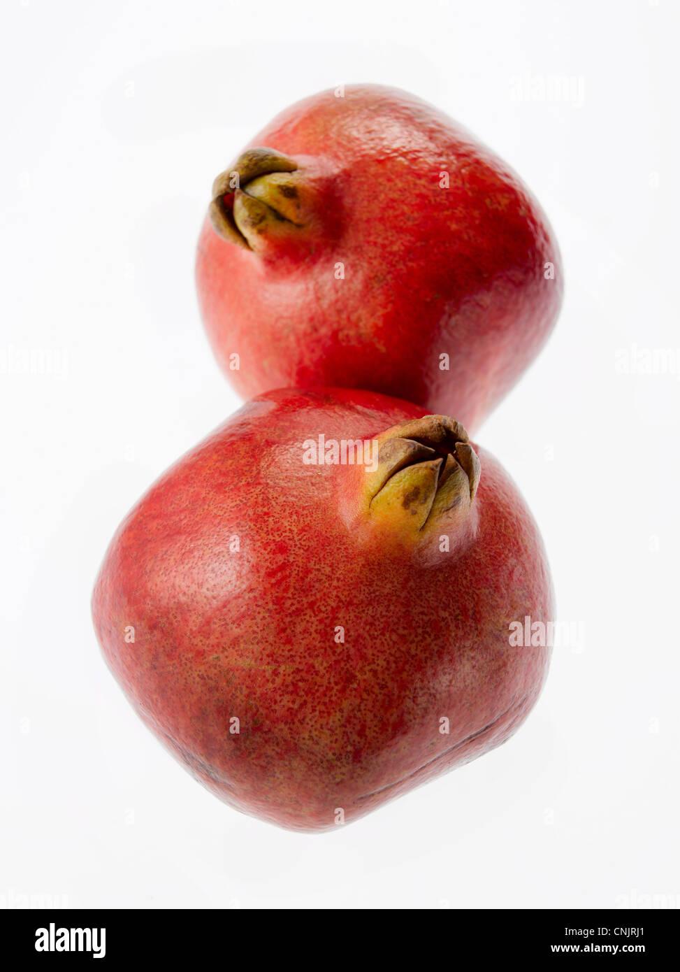 whole pomegranates - Stock Image