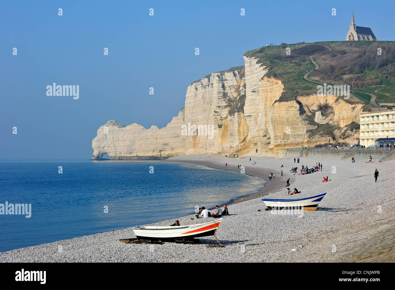 The chalk cliff Porte d'Amont and the chapel Notre-Dame-de-la-Garde at Etretat, Côte d'Albâtre, - Stock Image