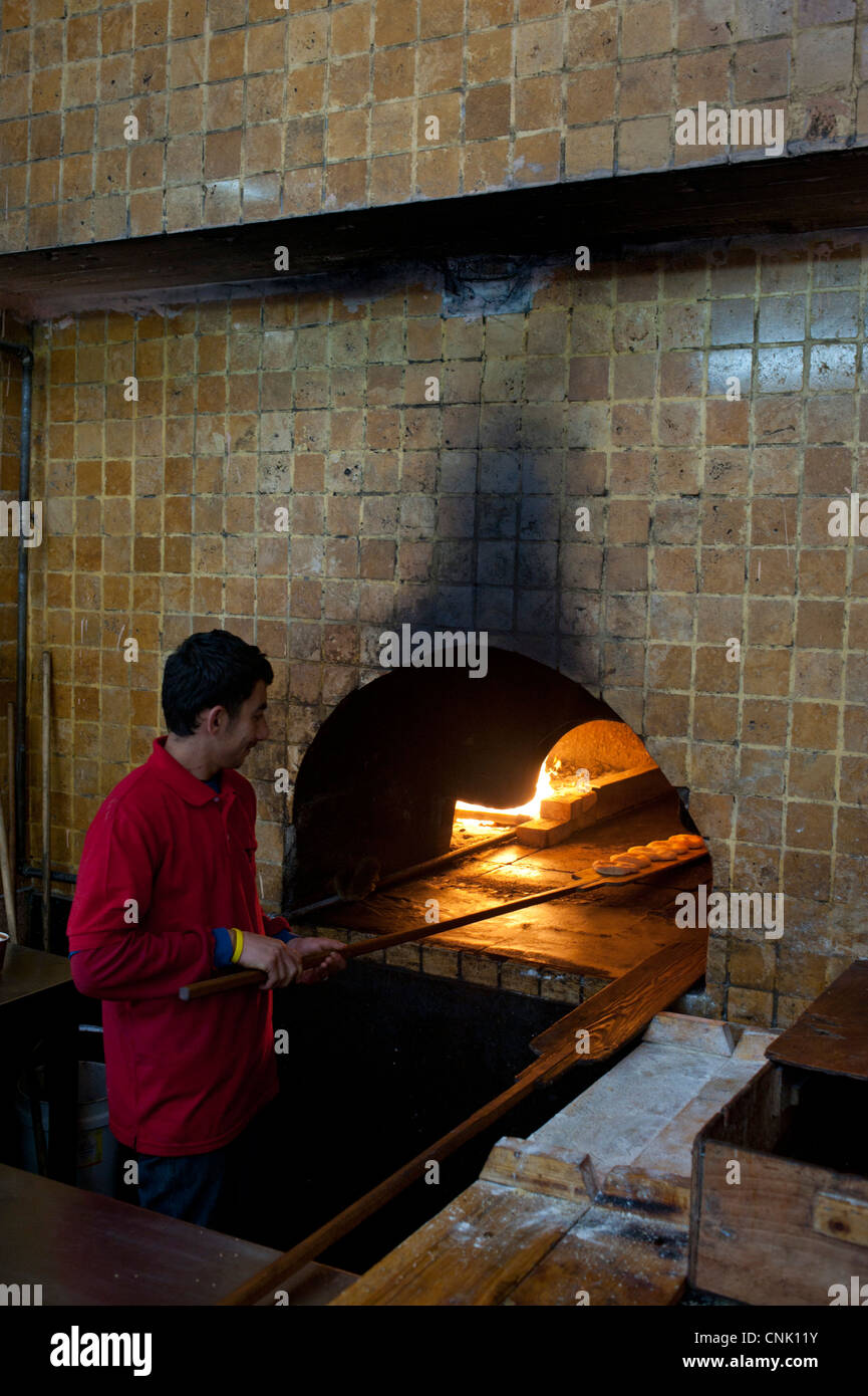 Middle East Israel jaffa a baker making breads in an old fire oven - Stock Image