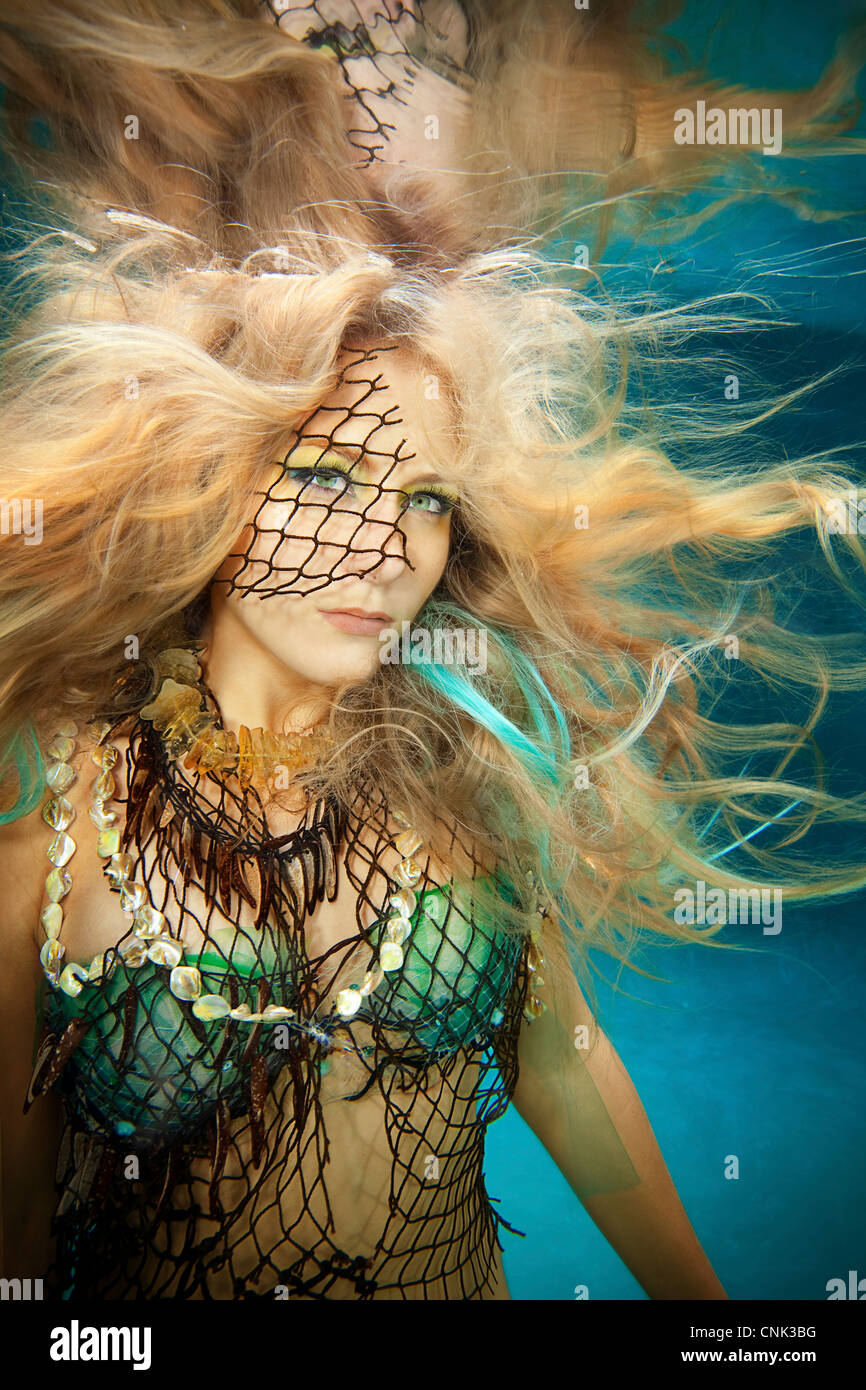 Blond mermaid in pool, Virginia Beach, Virginia. Stock Photo
