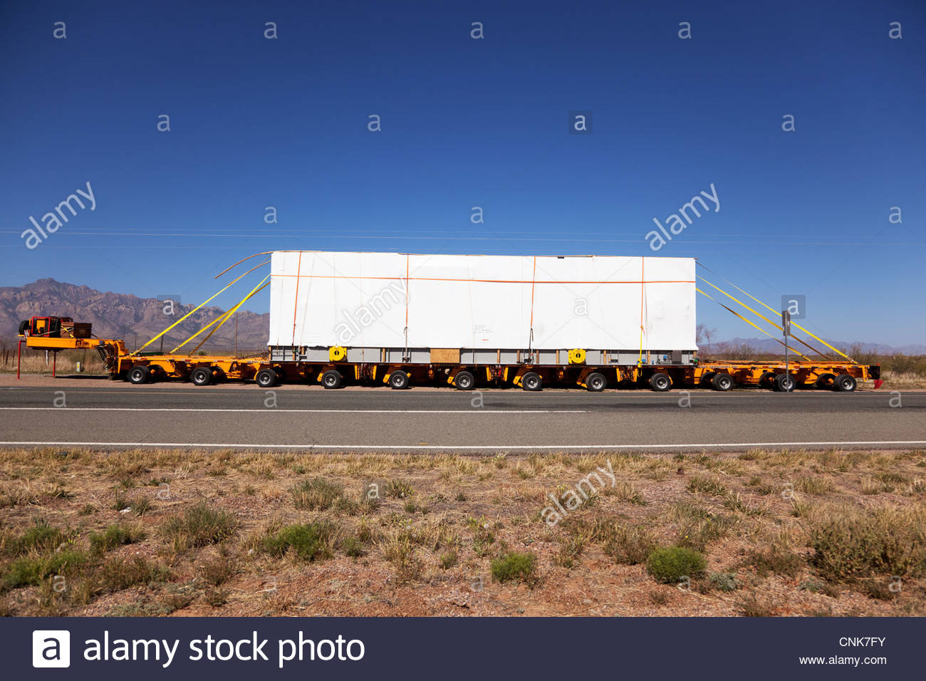 Heavy hauling oversize load parked 'New Mexico' - Stock Image