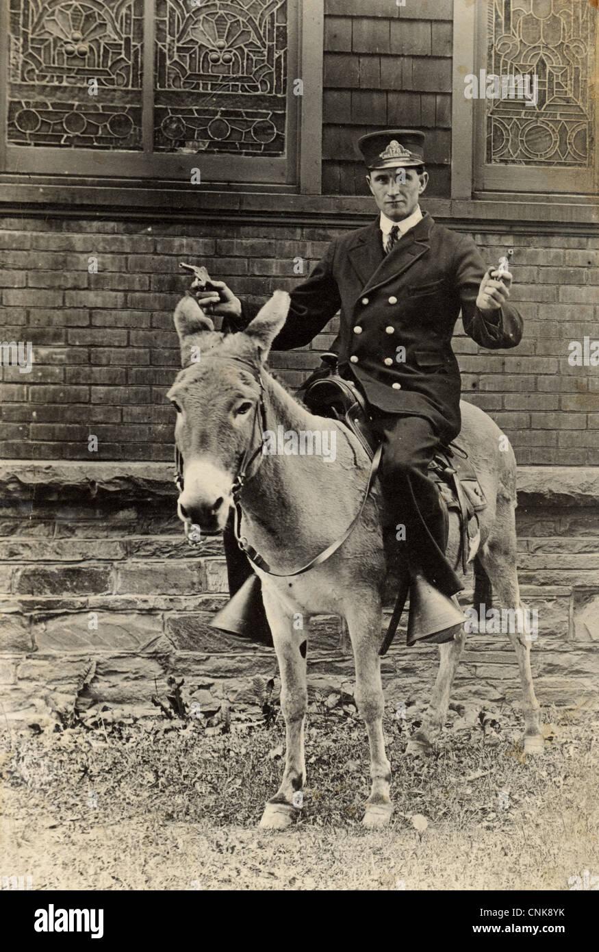 Heavily Armed Motorman Riding a Donkey - Stock Image