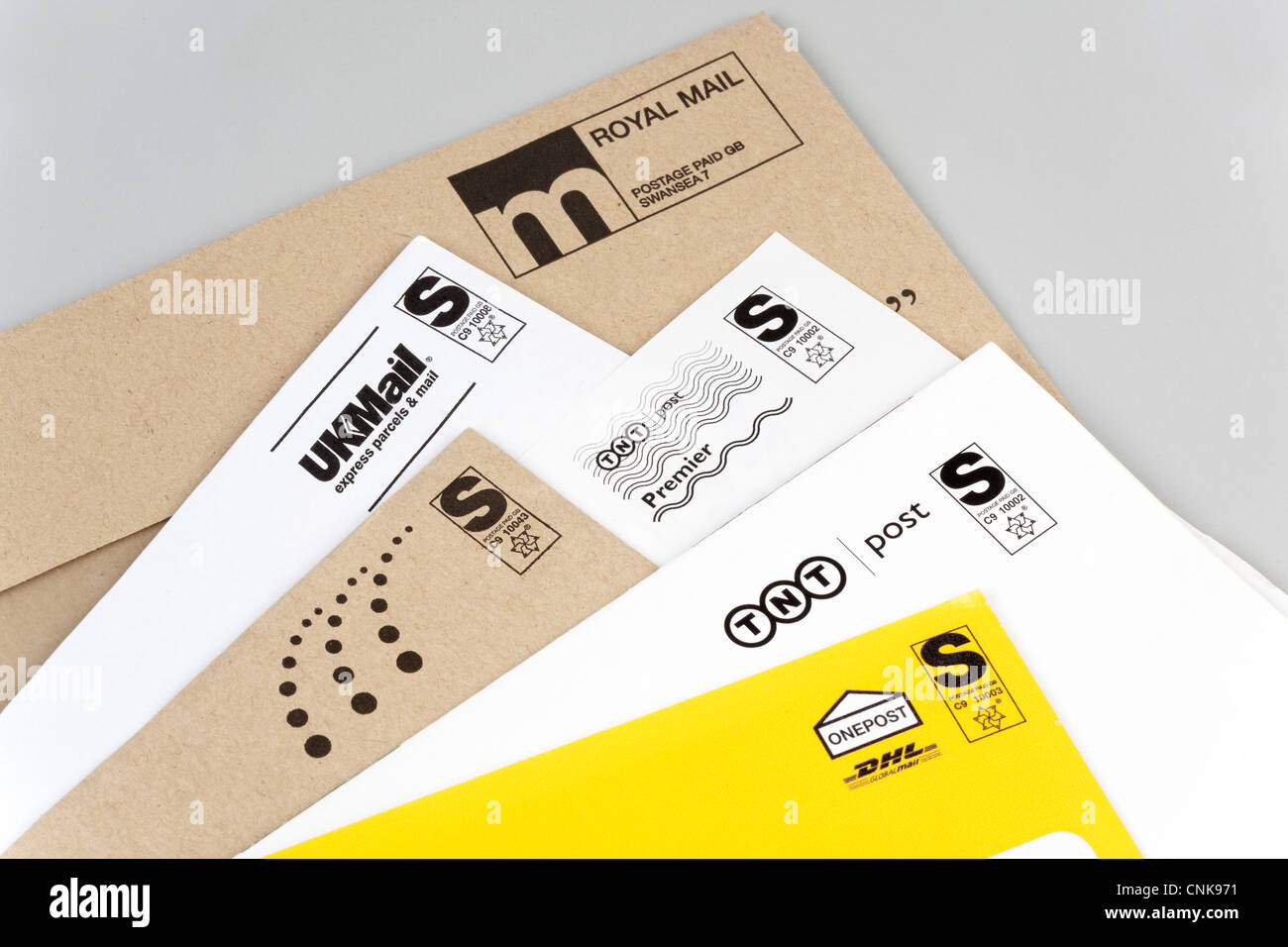 letters delivered by various postal delivery companies Stock Photo