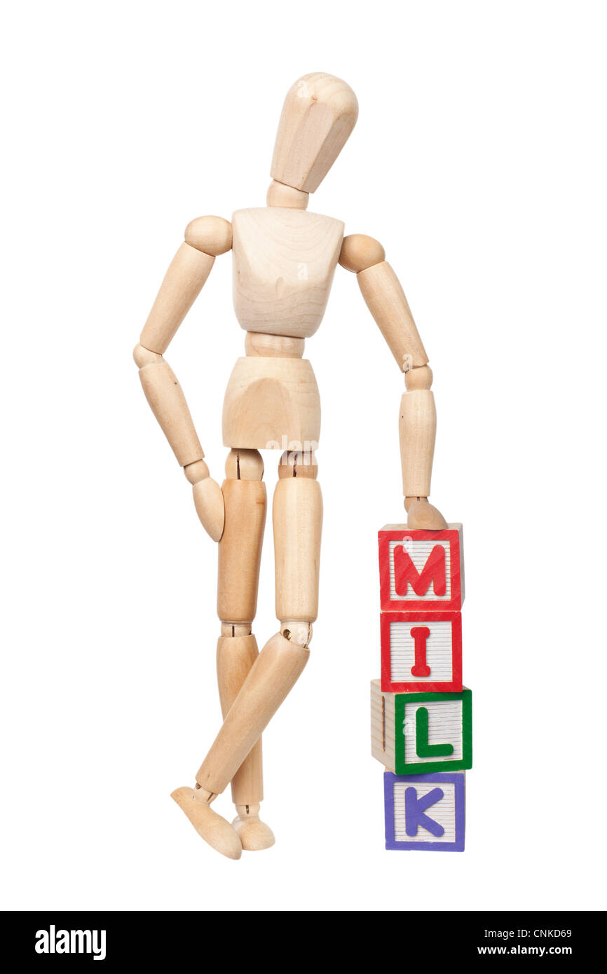 Wooden figurine with the word MILK isolated on white background - Stock Image