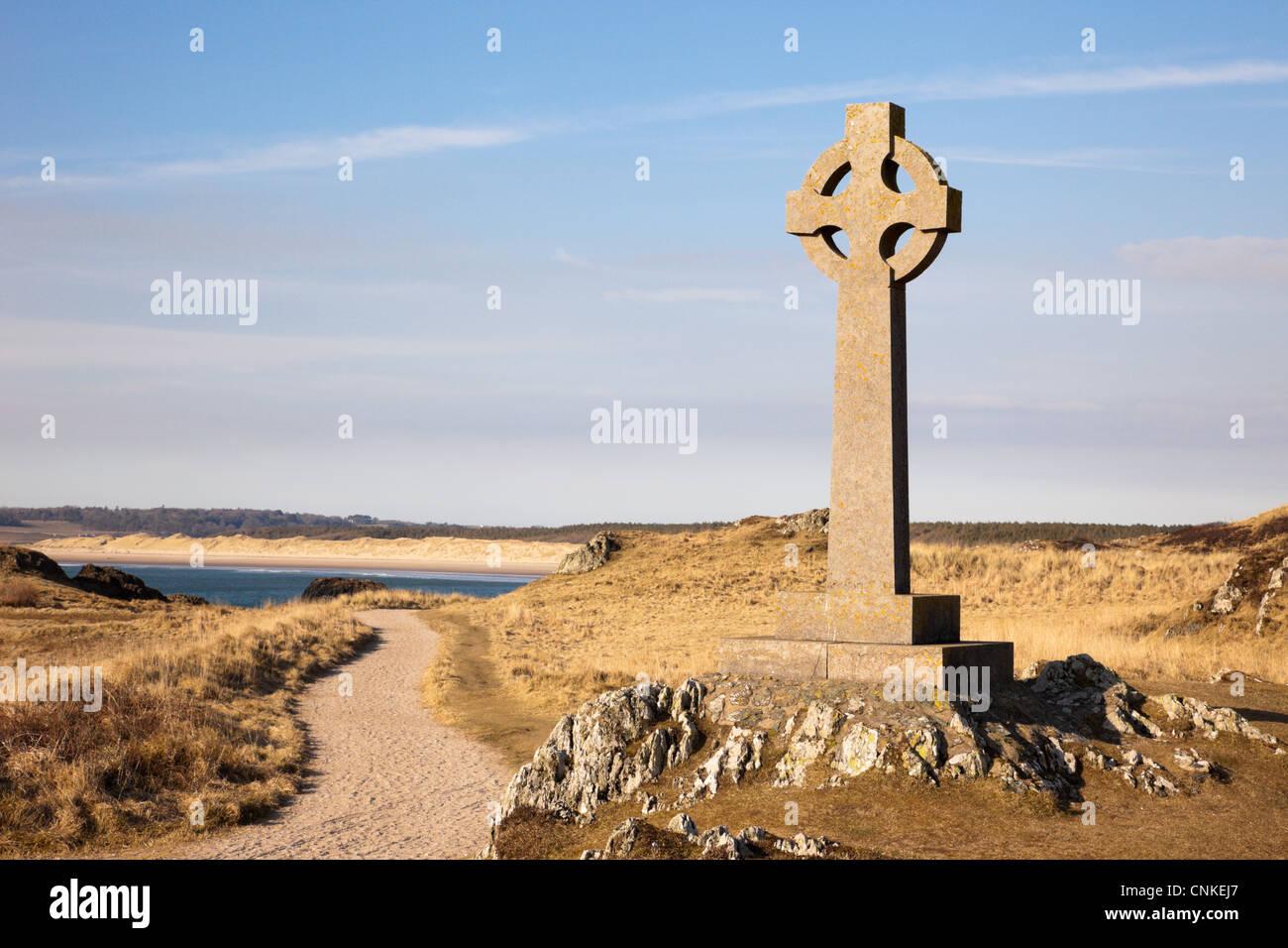 St Dwynwen's Celtic stone cross and path in National Nature Reserve and AONB. Llanddwyn Island, Newborough, - Stock Image