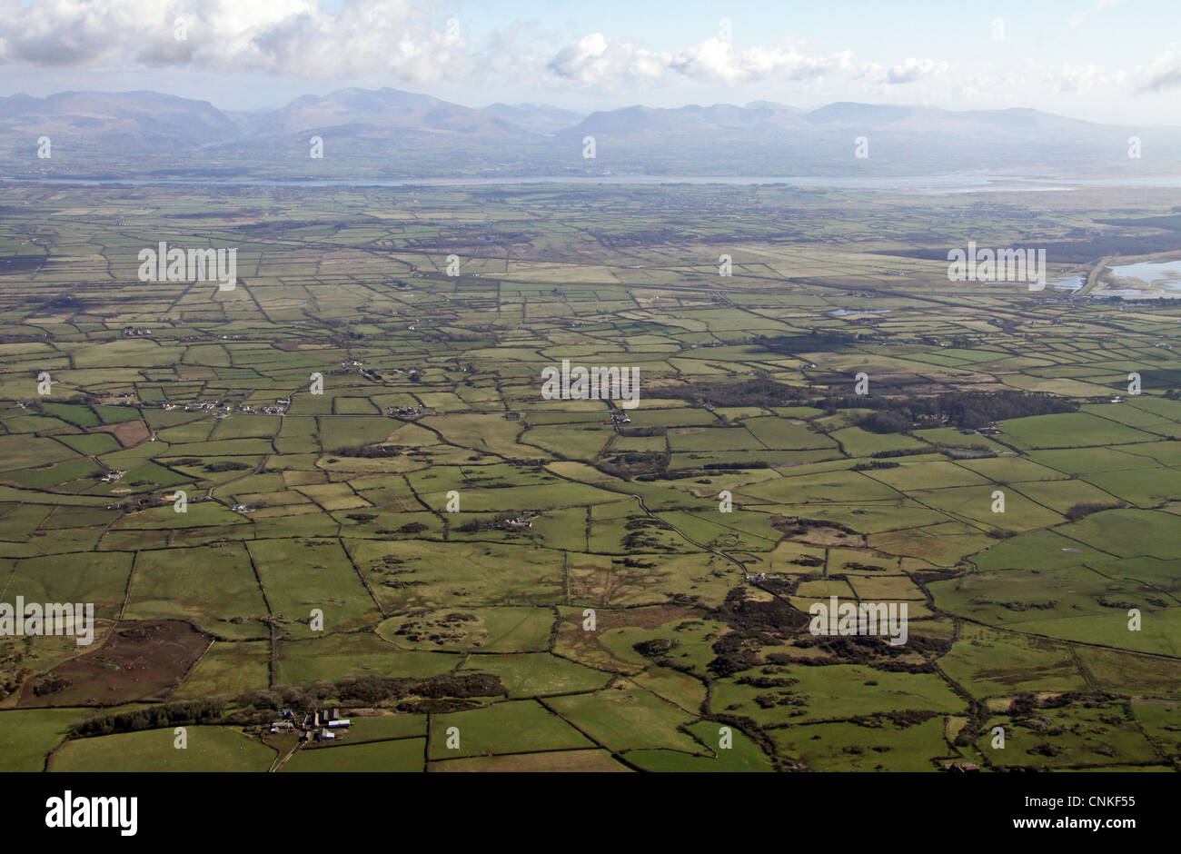 aerial view of the landscape of Anglesey looking east towards Snowdonia - Stock Image