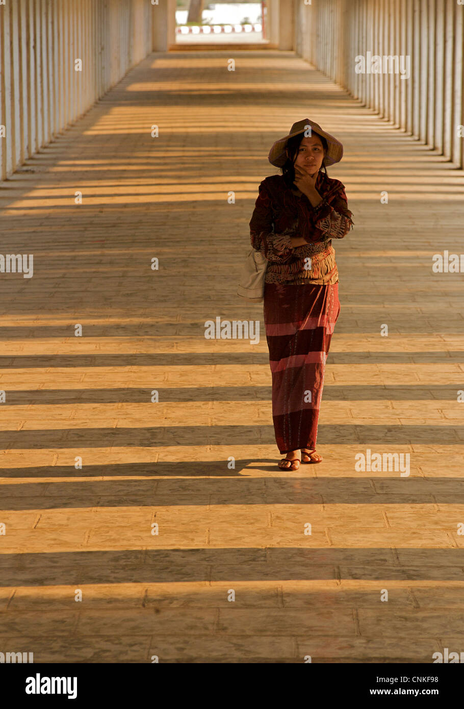 Burmese woman in the corridor at Shwezigon Pagoda, Bagan. Burma. Model Released. - Stock Image