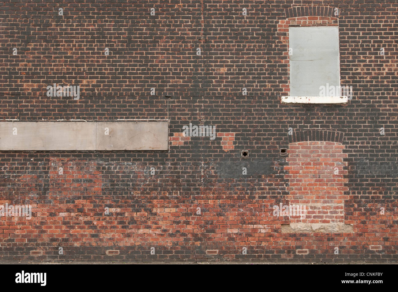 The gable end of a house with bricked up windows - Stock Image